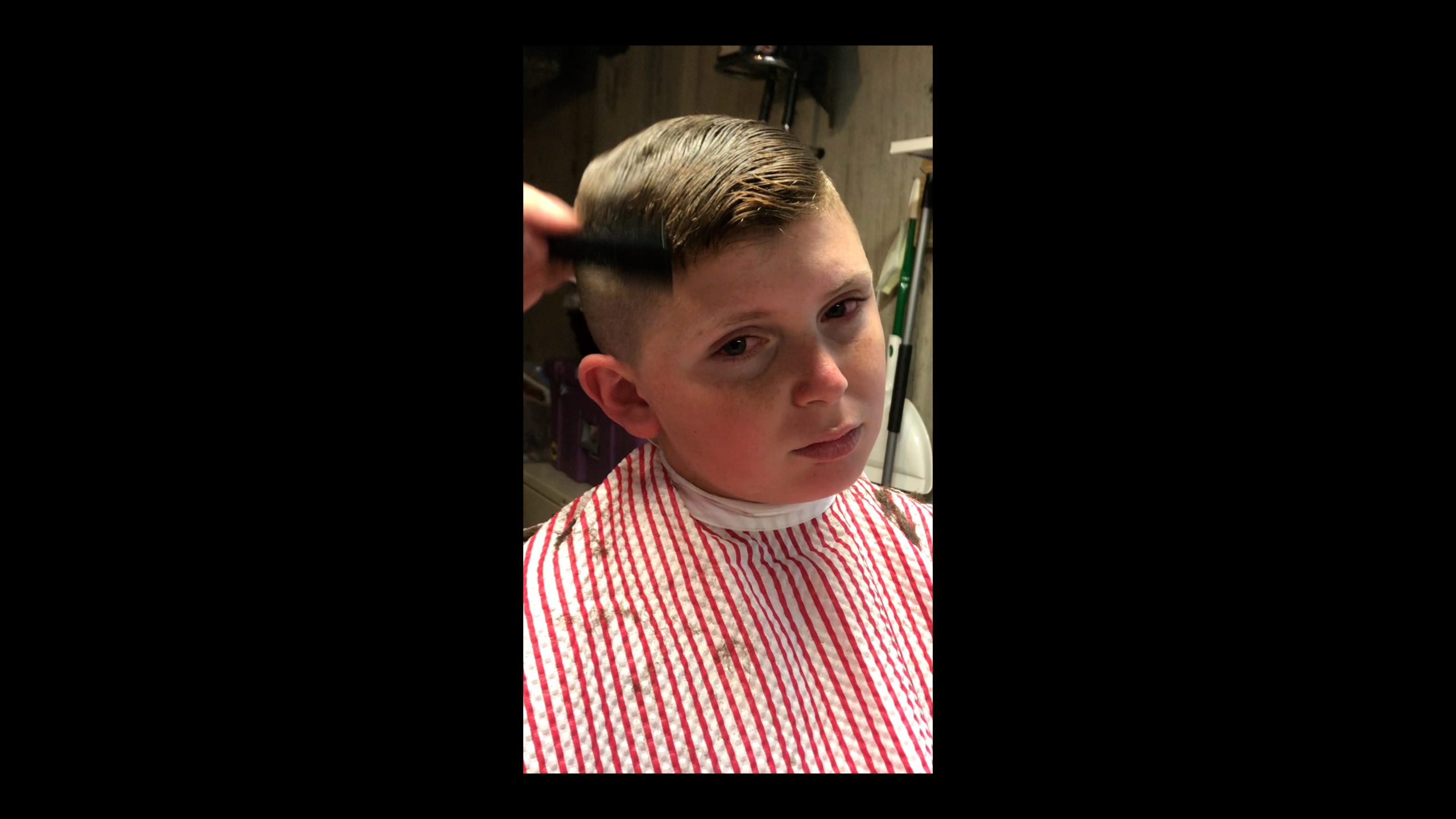 Nick Mazzeo gives a home haircut to Dominic Mazzeo.