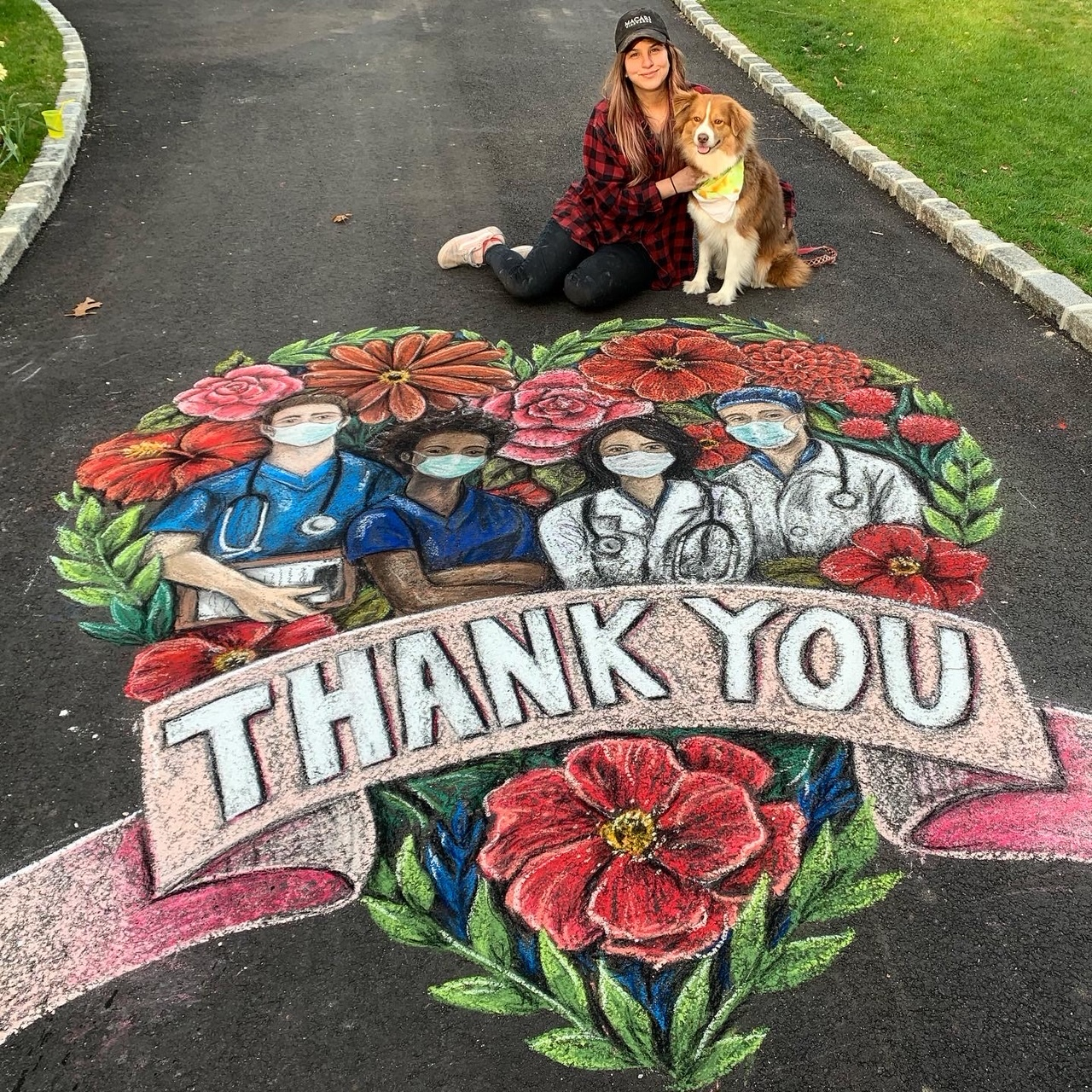 Chalk artist Kara Hoblin with her dog, Lily, and the driveway tribute to healthcare workers that went viral.