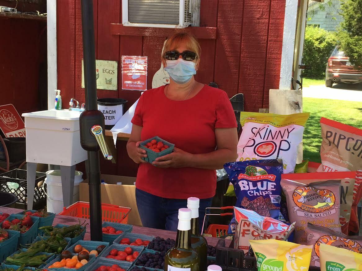 Vicki Littman has fresh strawberries for sale. KITTY MERRILL