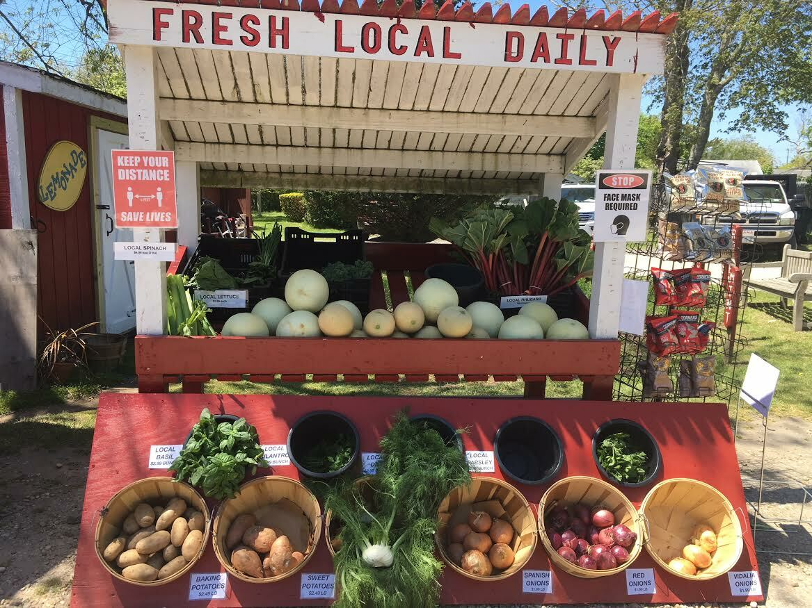 The farmstand's layout has been reconfigured to display produce towards cars in the driveup line. KITTY MERRILL
