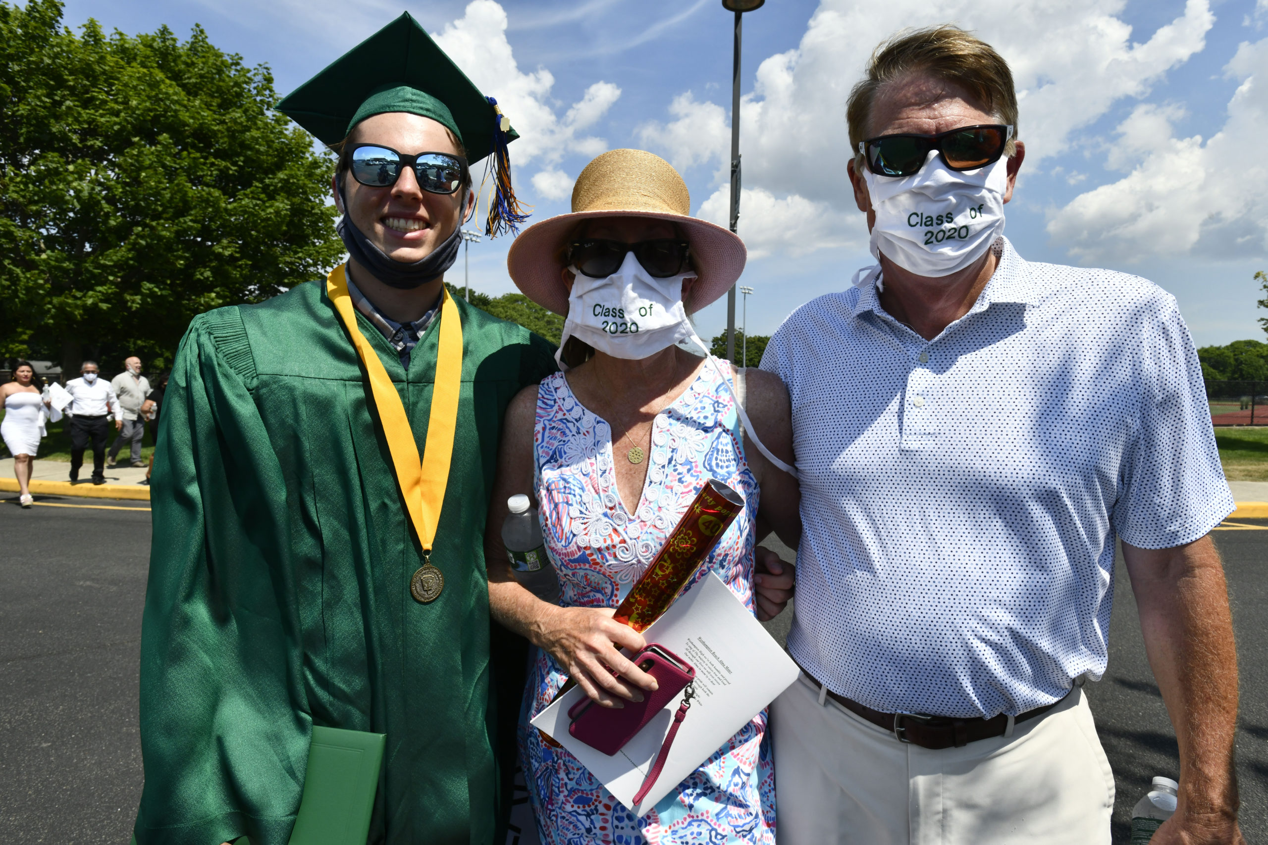 Westhampton Beach graduate Blake Busking with his parents Deborah and Bob.