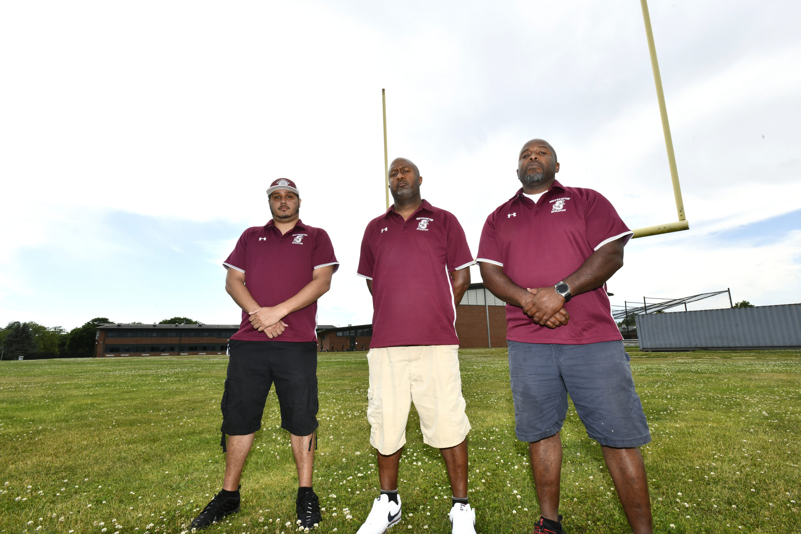 Southampton Football Coach Chris Campbell, center, with assistant coaches Shawn Smith and Eddie West.   DANA SHAW