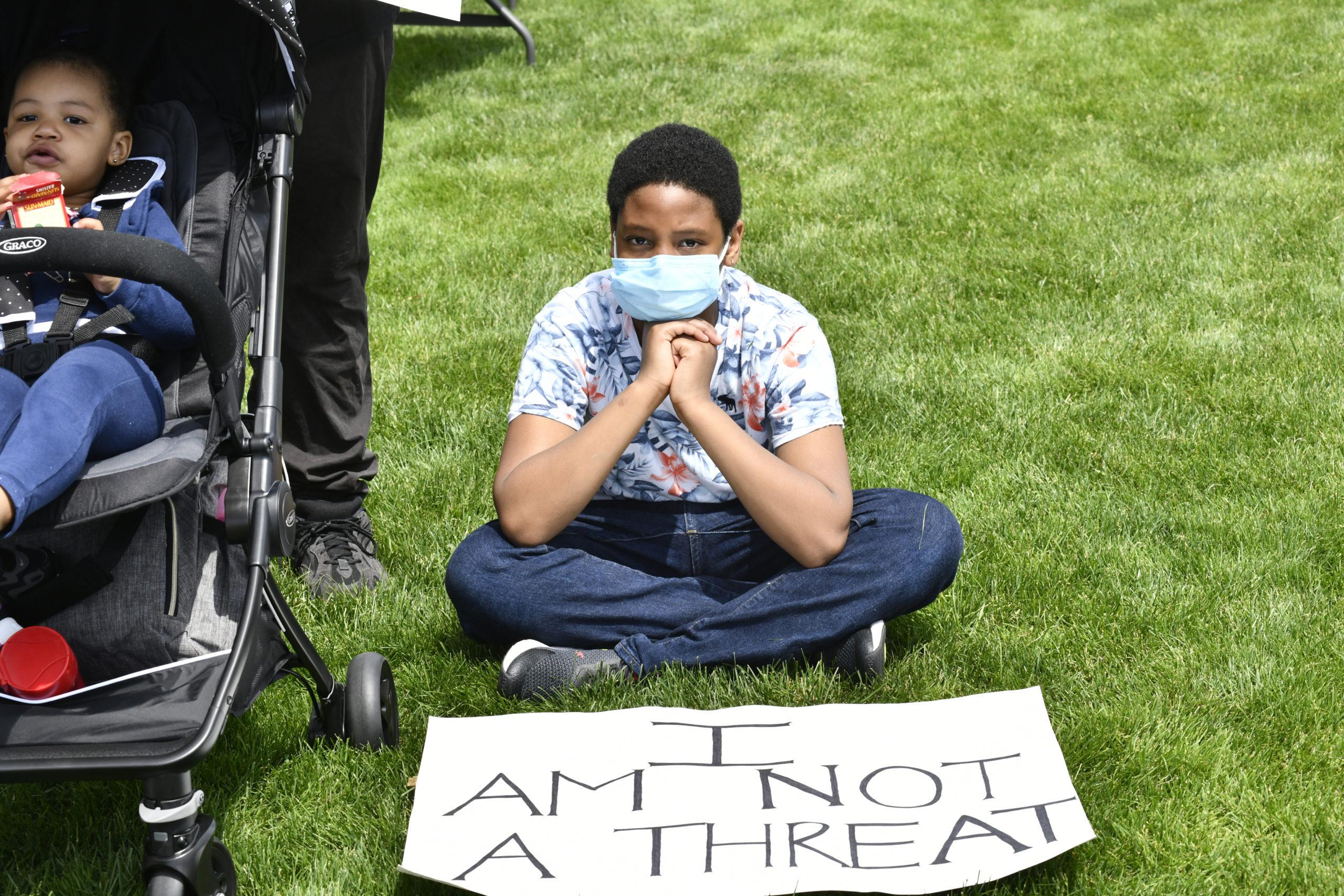 Kaiden Davis, 10, of Southampton at the vigil in Agawam Park on Thursday.  DANA SHAW