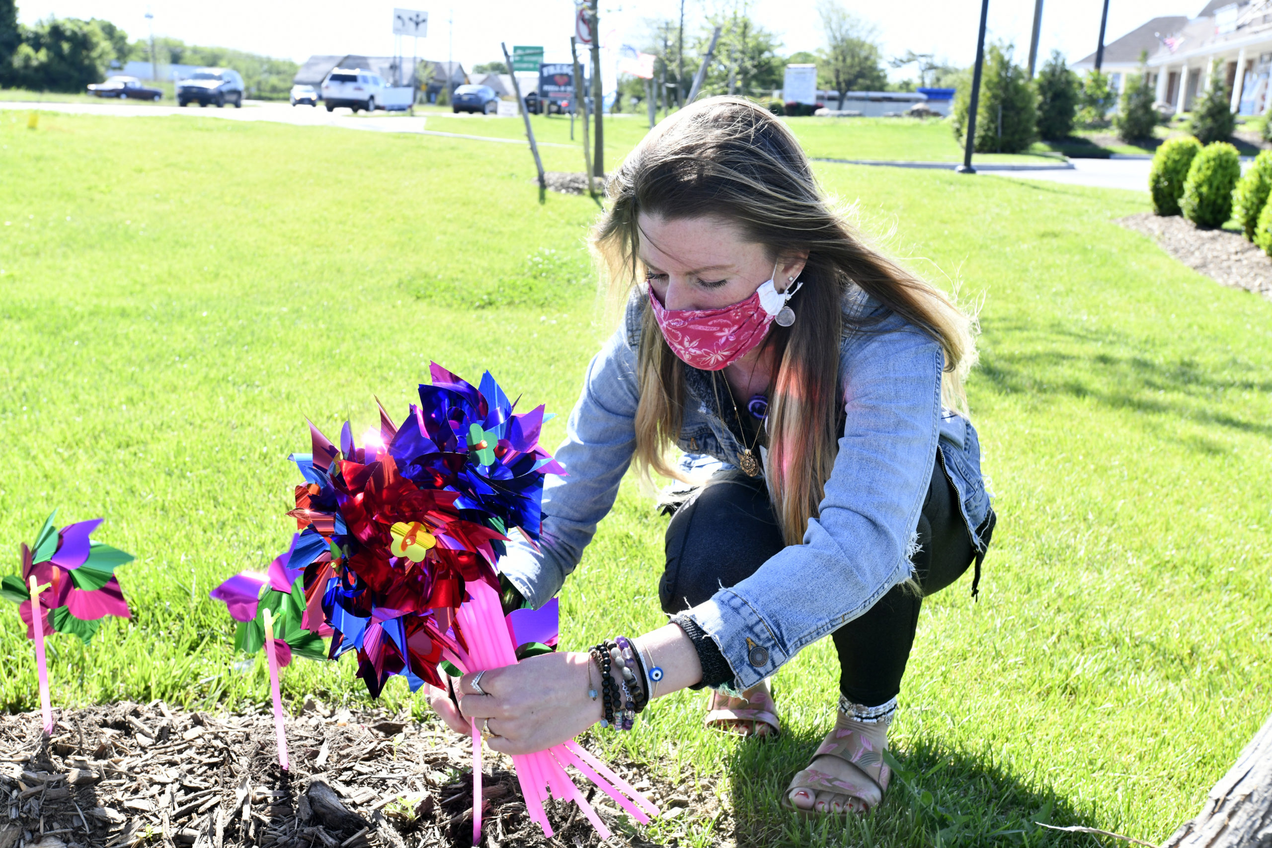 Lauren Richard-Holt a social worker at The Phillips Family Cancer Center at Stony Brook Southampton Hospital led a small group of volunteers in planting 200 pinwheels in celebration of National Cancer Survivors Day at the center on Sunday.  DANA SHAW
