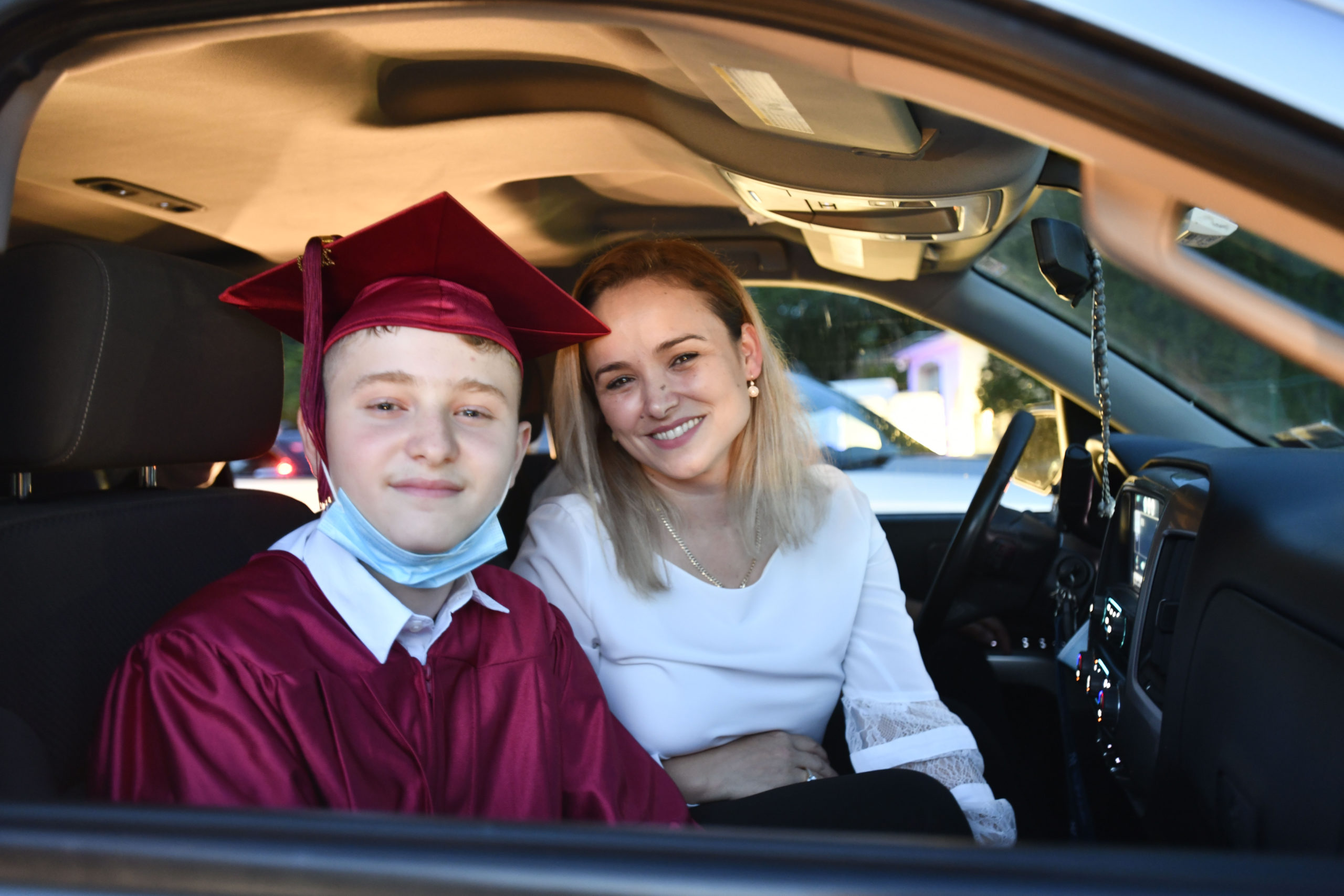 Tuckahoe School co-valedictorian Erion Ruhani, with his mom Valdete, at the Tuckahoe School eighth grade graduation ceremony on Thursday night. DANA SHAW