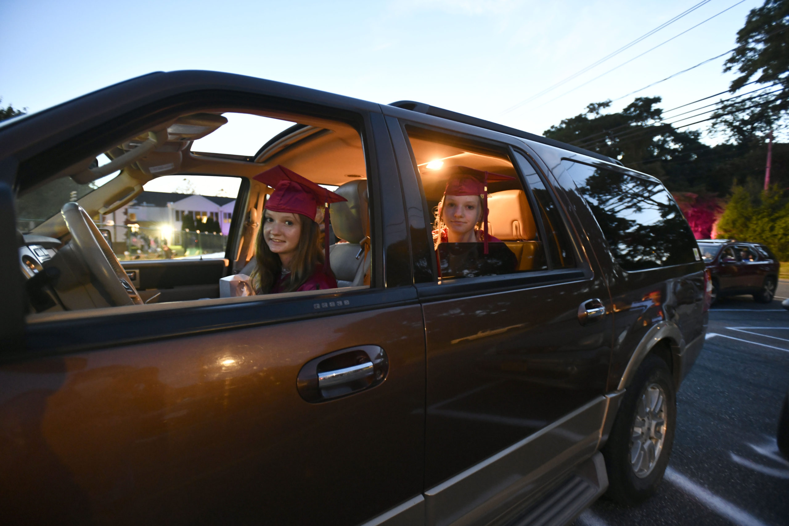 Alison and Claire Schneider wait their turn to go on stage to collect their diplomas at Tuckahoe School's eighth grade graduation on Friday.  DANA SHAW