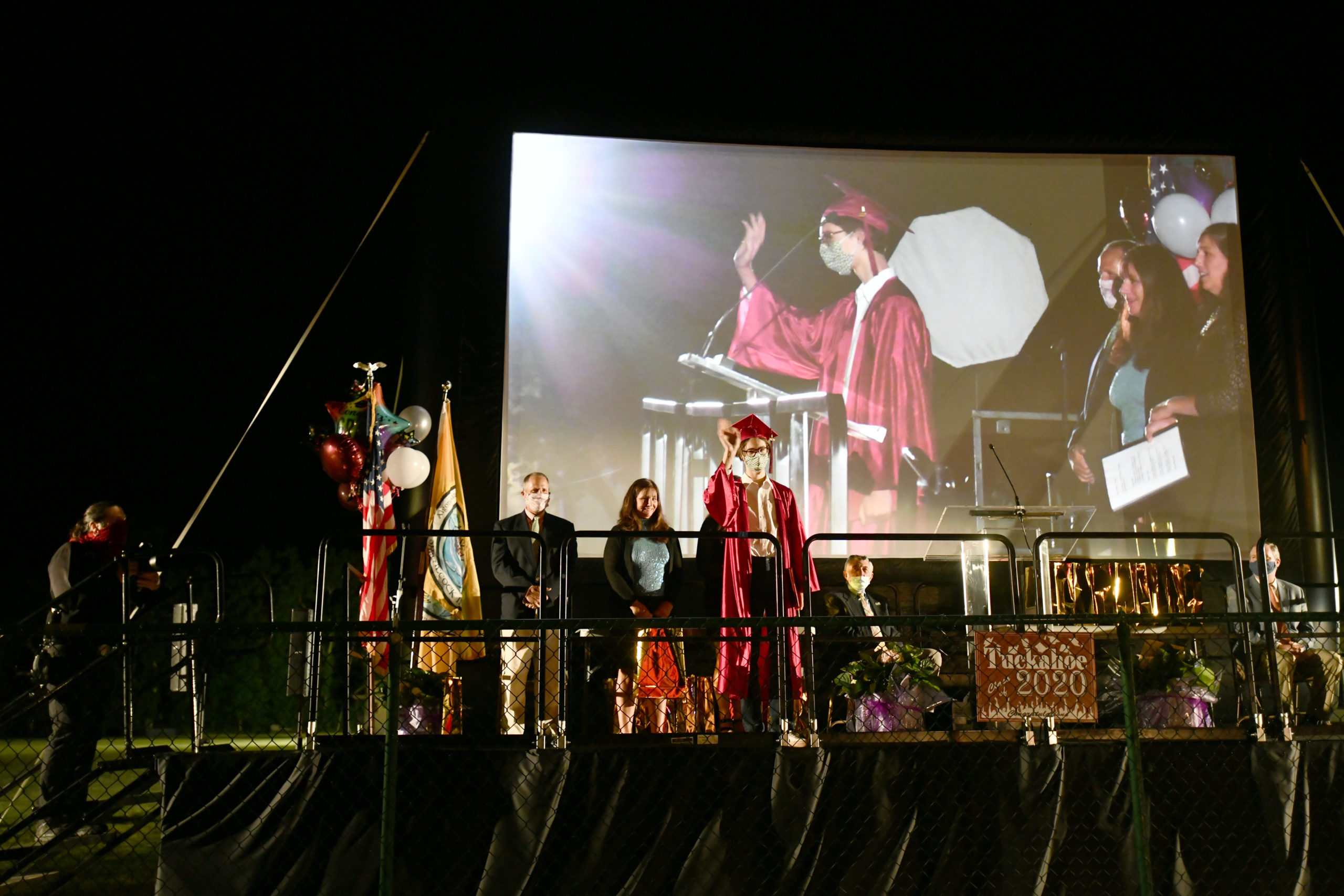 Tuckahoe School celebrated its eighth-grade commencement with a drive-in graduation on Thurdsay night. Parents stayed in their cars while students went on stage to accept their diplomas.  DANA SHAW