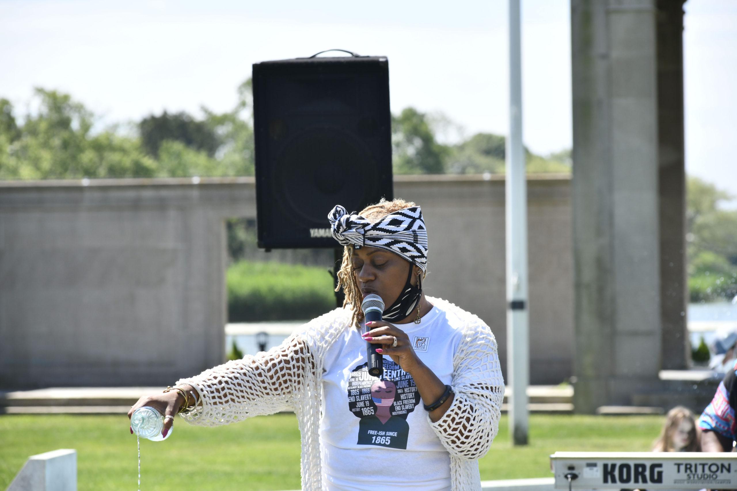 Hamptons United Methodist Church Pastor Leslie Duroseau speaks at the Junteenth celebration in Agawam Park on Friday. DANA SHAW