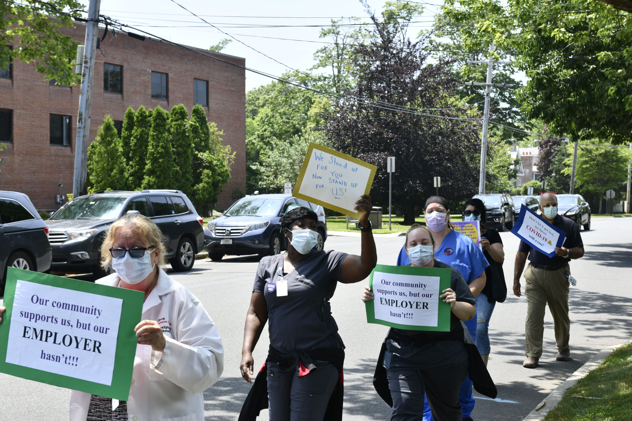 Healthcare workers picket outside of Stony Brook Southampton Hospital on Wednesday afternoon. DANA SHAW