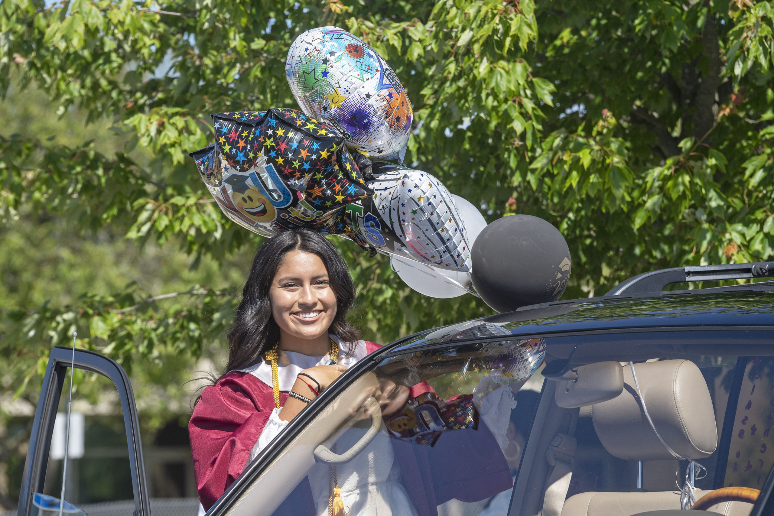 East Hampton High School Senior Katherine Quivhpe gets ready to participate in the 2020 graduation ceremony at the East Hampton High School on Friday.