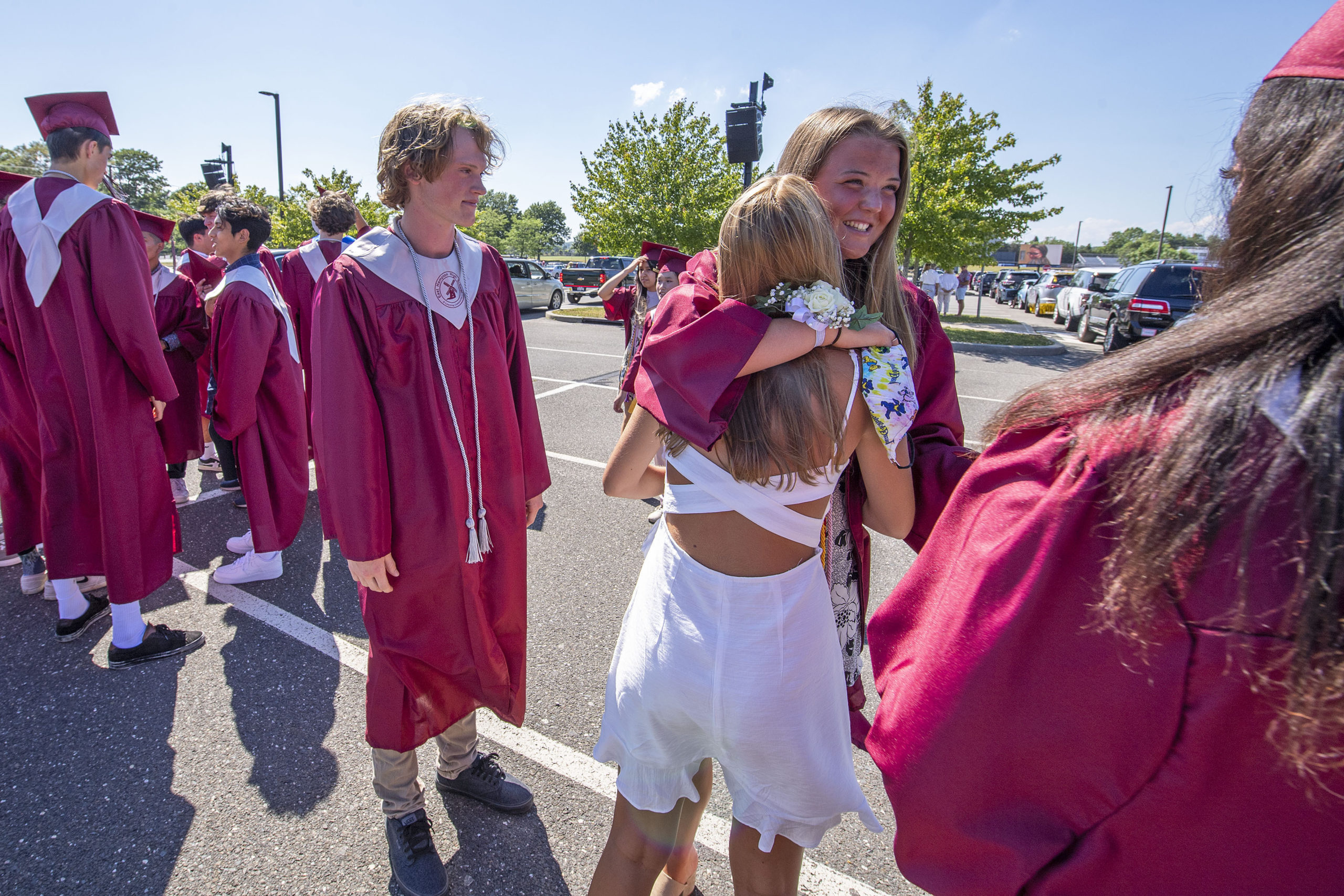East Hampton High School Seniors traded hugs and smiles as they got ready to participate in the 2020 graduation ceremony at the East Hampton High School on Friday.