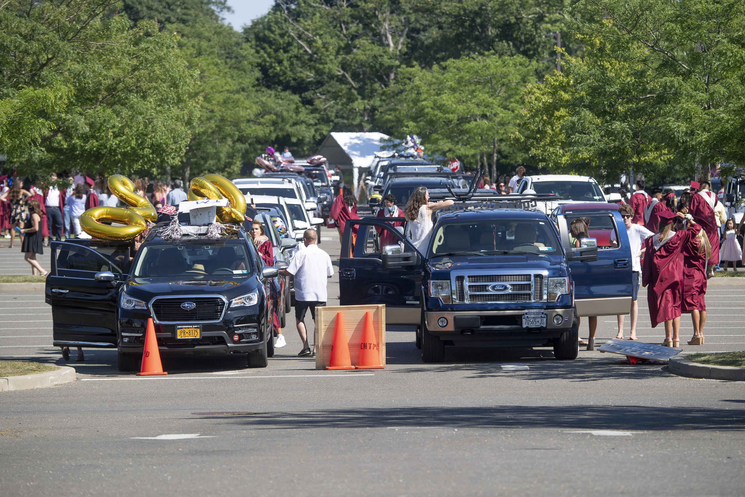 Cars line up in the parking lot by district as the seniors' families get ready to participate in the 2020 graduation ceremony at the East Hampton High School on Friday.