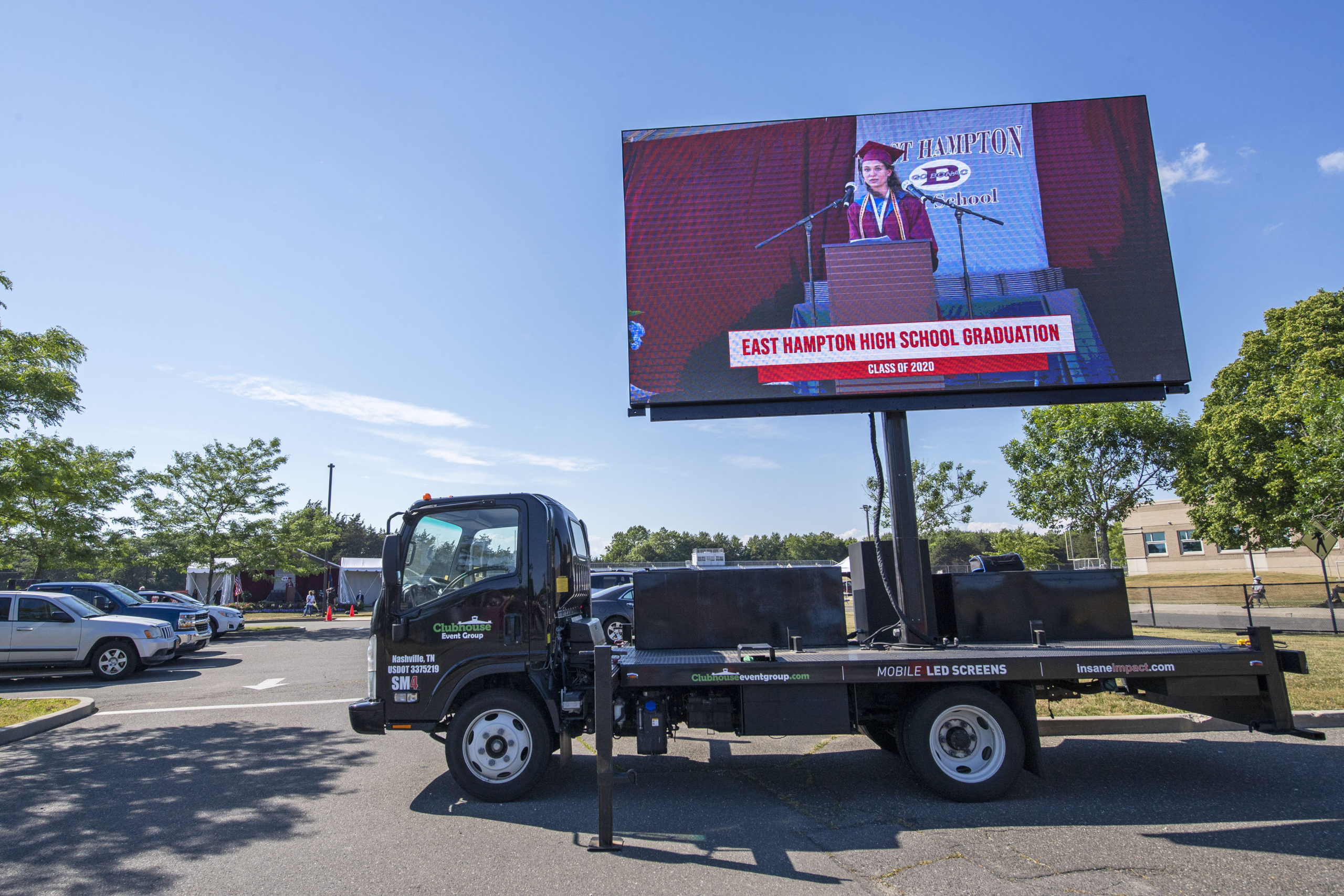 Families in their vehicles were able to watch on a mobile LED screen as East Hampton High School Senior Valedictorian Samantha Prince speaks during the 2020 graduation ceremony at the East Hampton High School on Friday.