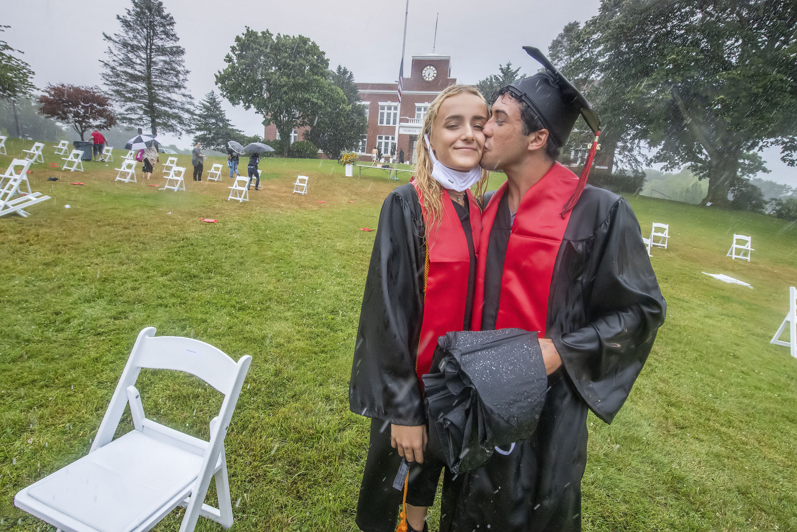 Ellie Borzilleri gets a kiss from classmate Patrick Chisholm following the Pierson High School 2020 Commencement Ceremony at Pierson High School on Saturday.