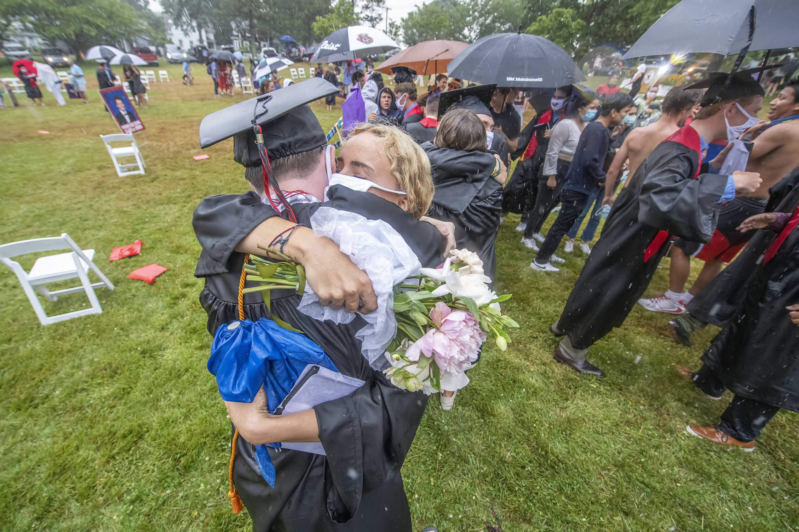 Ellie Borzilleri gets a big hug from Dylan Kruel following the Pierson High School 2020 Commencement Ceremony at Pierson High School on Saturday.