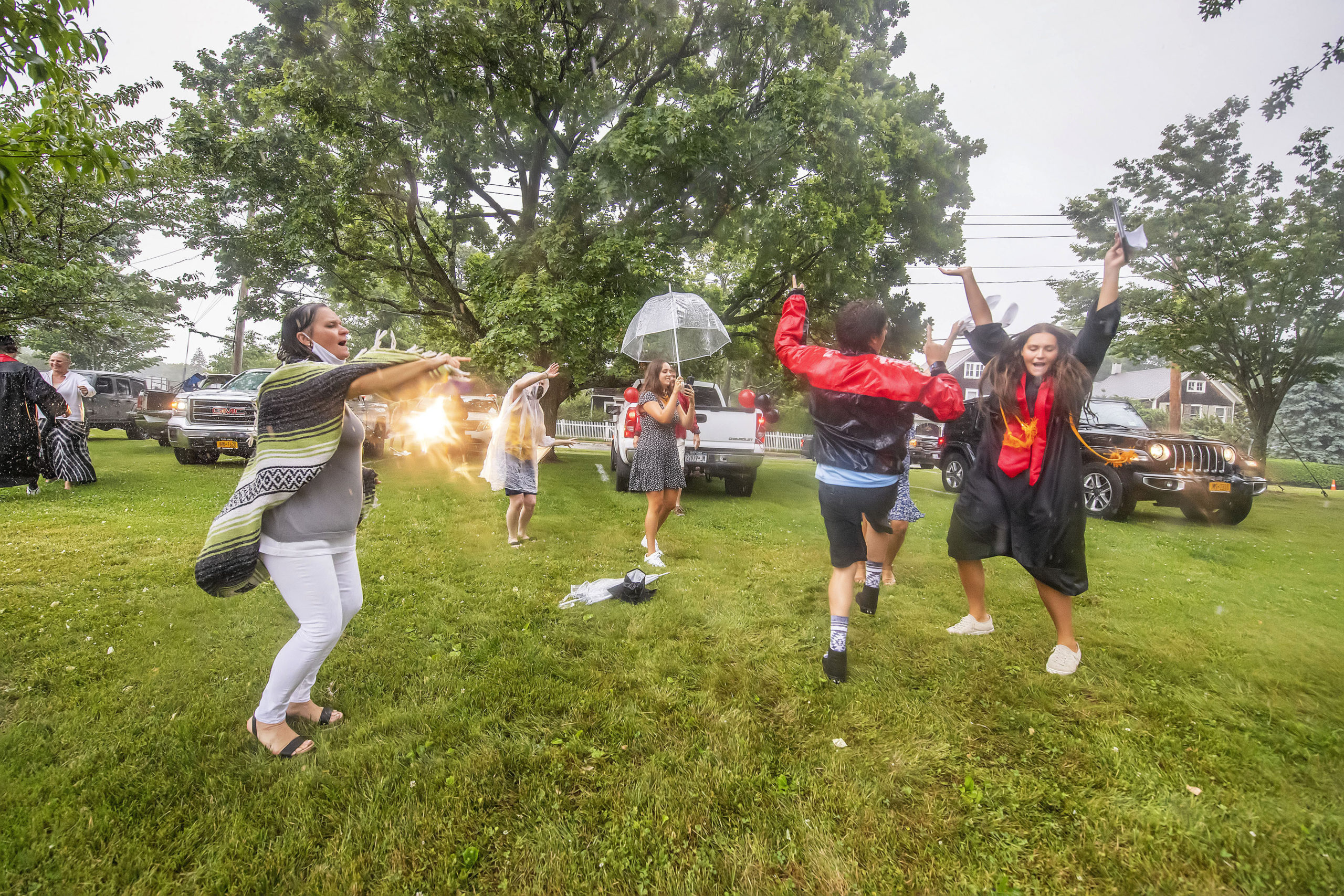The Nill family dances for joy in the rain after daughter Haley - at far right- graduated in the Pierson High School 2020 Commencement Ceremony at Pierson High School on Saturday.