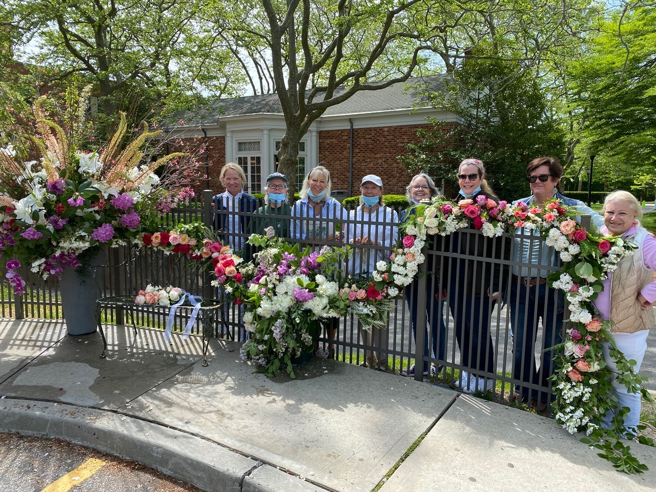 Members of The Southampton Garden, left to right: Deb dela Gueronneire, Lydia Wallis, Cindy Willis, Christl Meszkat, Janis Murphy, Barbara Glatt, Erin Meaney, Elizabeth Robertson, created a surprise 'Flower Flash' on the grounds of Stony Brook Southampton Hospital earlier this month to thank staff and employees for all they do for our community. Using flowers from local flower shop Topiare and member's own gardens, the display was conceived and executed under the direction of club president Barbara Glatt and members Erin Hattrick Meaney and Cindy Willis.