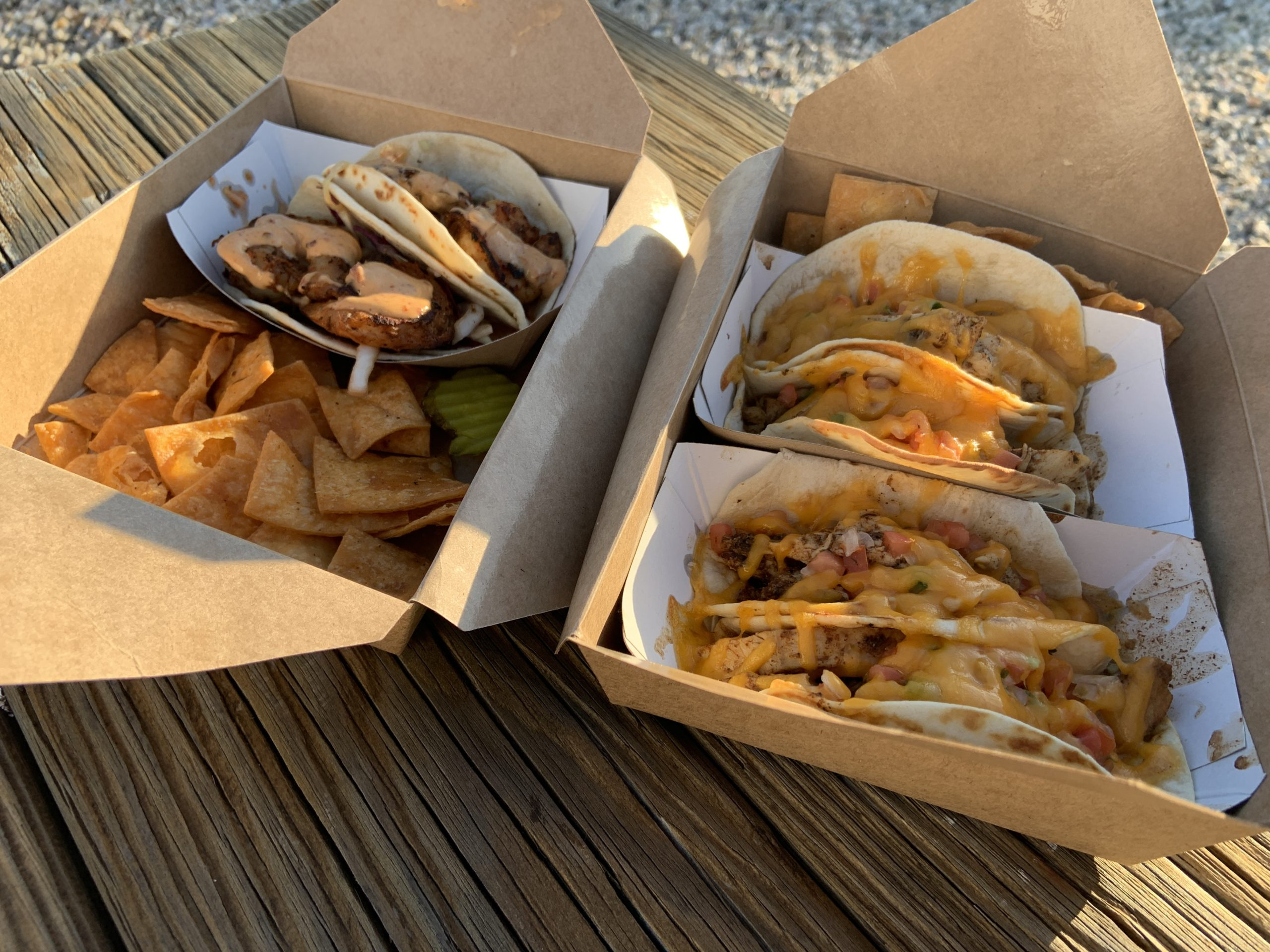Shuckers shrimp tacos, left, and two orders of chicken tacos, right.
