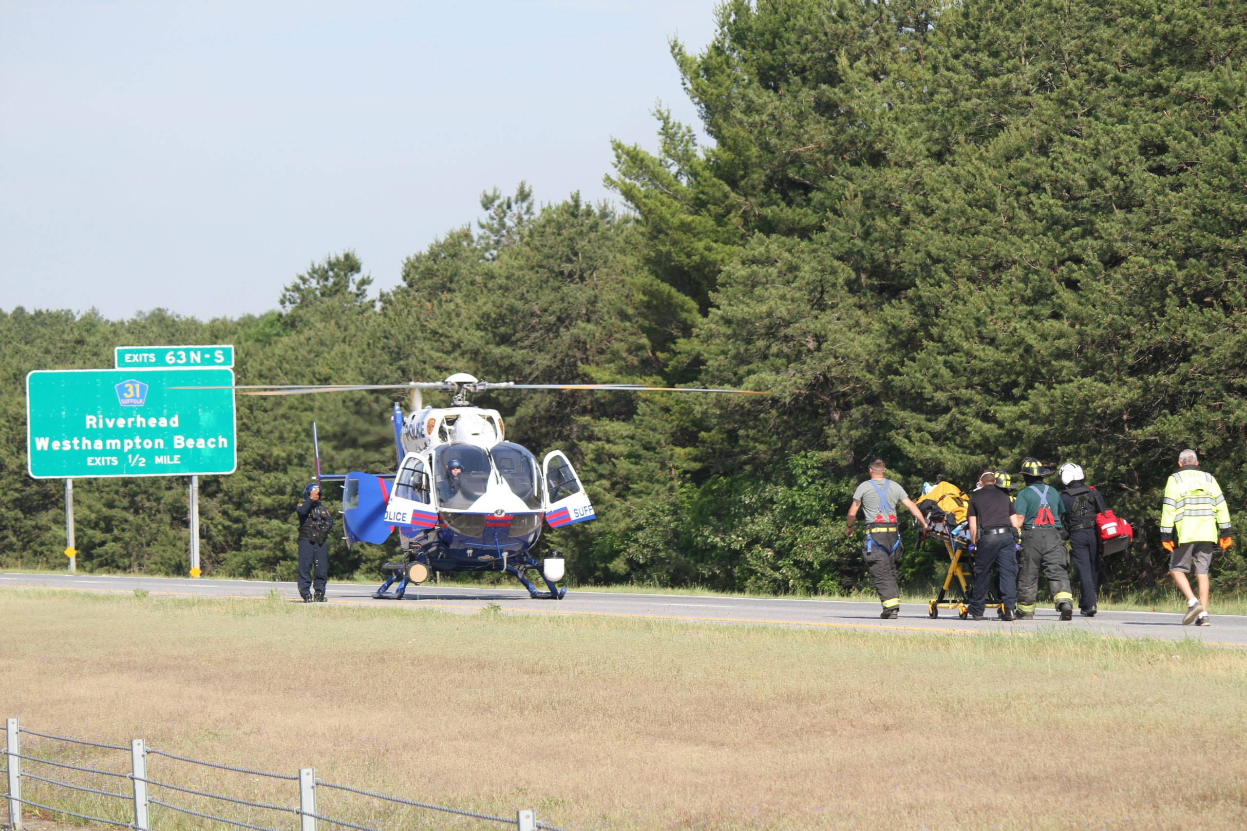 A Medevac helicopter landed on the westbound lanes of Sunrise Highway on Friday morning to transport a man who was seriously injured when his car flipped over.