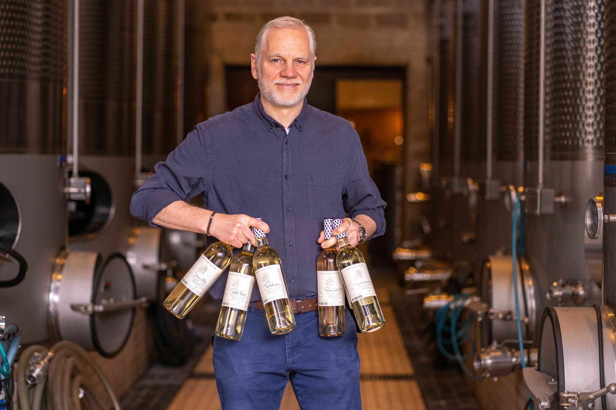 Wölffer Estate Vineyard's winemaker Roman Roth with the Cellar Series collection of small batch releases of artisanal wines.