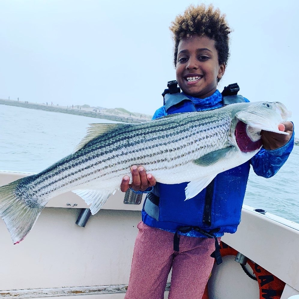 Auggie Baker decked this nice slot keeper striped bass while fishing in Shinnecock Inlet with Capt. Brad Ries of Someday Came Charters last week.