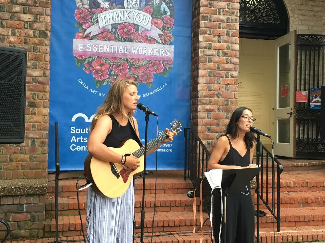 Two singers performing on the steps of the Southampton Arts Center serenaded a cluster of fans on Jobs Lane. KITTY MERRILL