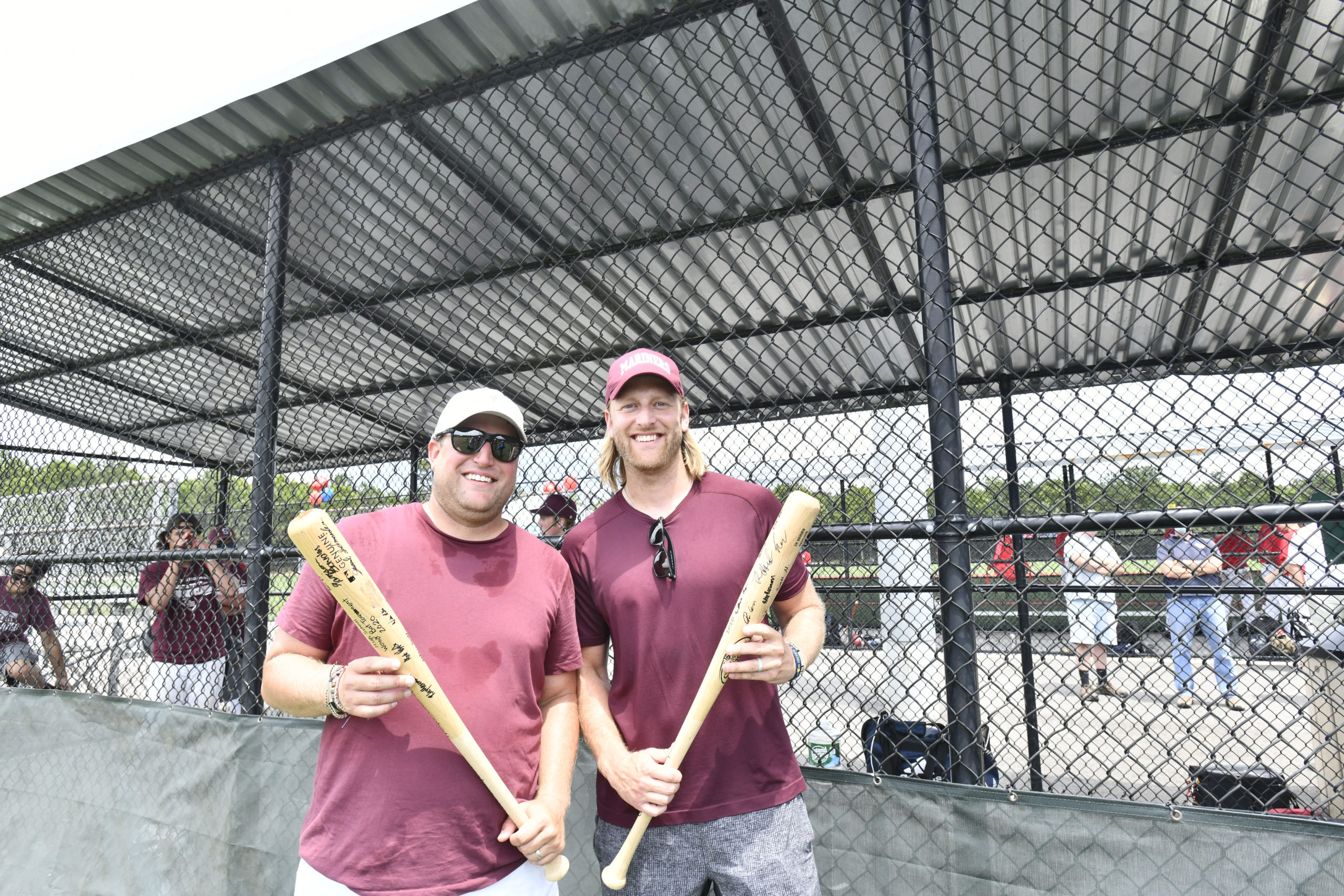 Mariner coaches Zach and Nick Epley with bats that the team signed.  DANA SHAW