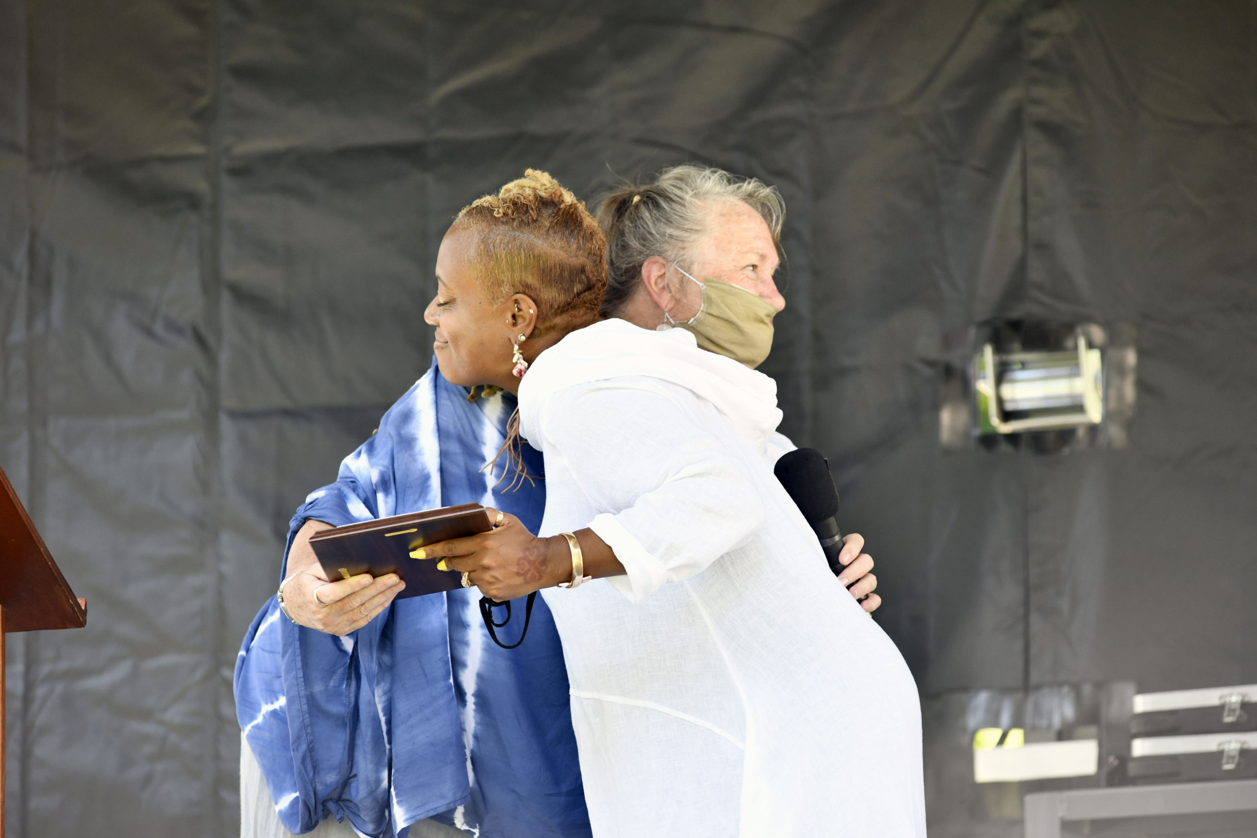 Parishioners and friends and well-wishers came to the grounds of the Southampton Arts Center to bid farewell to Reverend Leslie Duroseau of the Hamptons United Methodist Church in Southampton Village on Sunday. Carol Gilbert Lynch presents Rev. Duroseau with a plaque. DANA SHAW