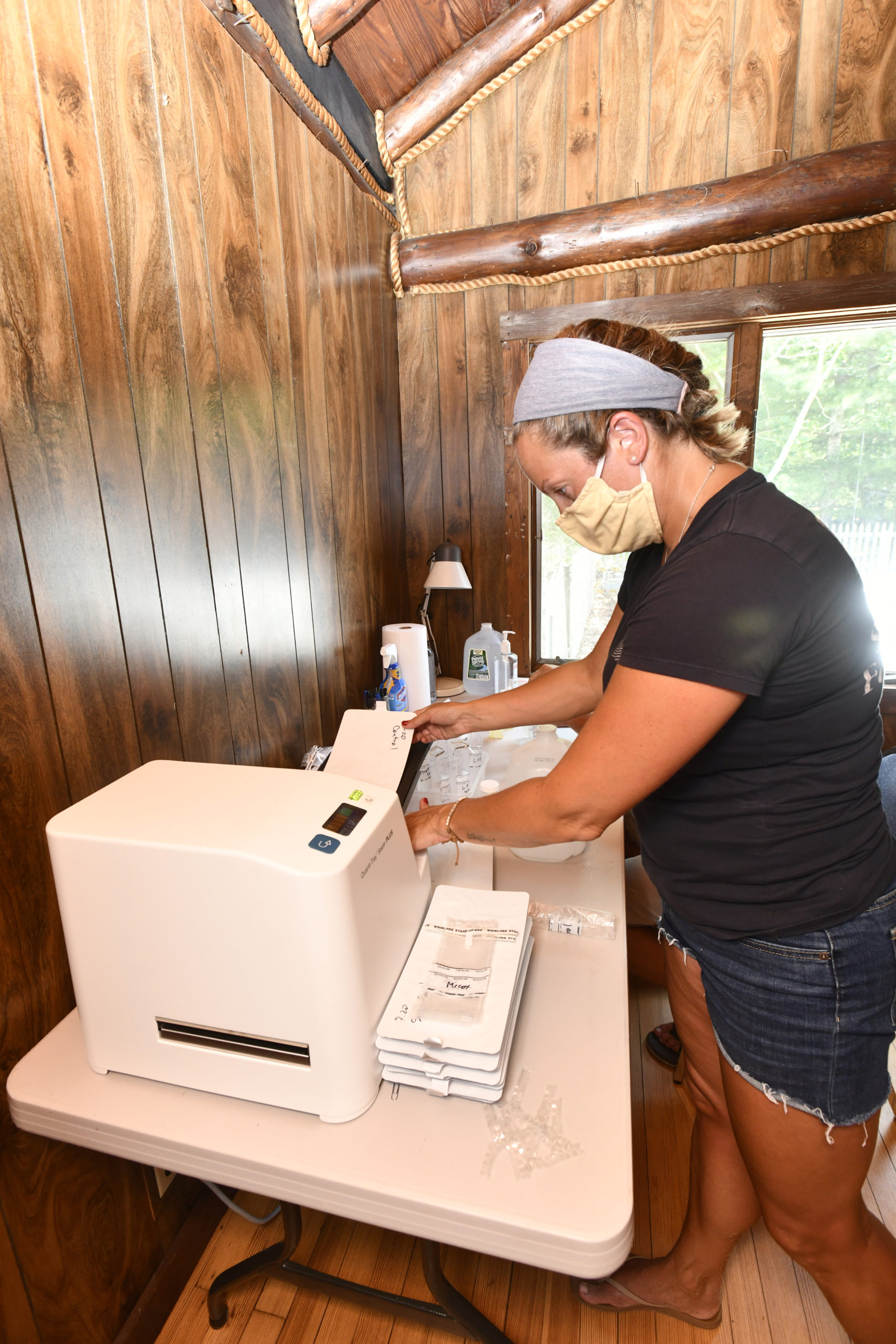 Jillian Kampf, the regional coordinator for the Surfrider Foundation runs some water samples. DANA SHAW