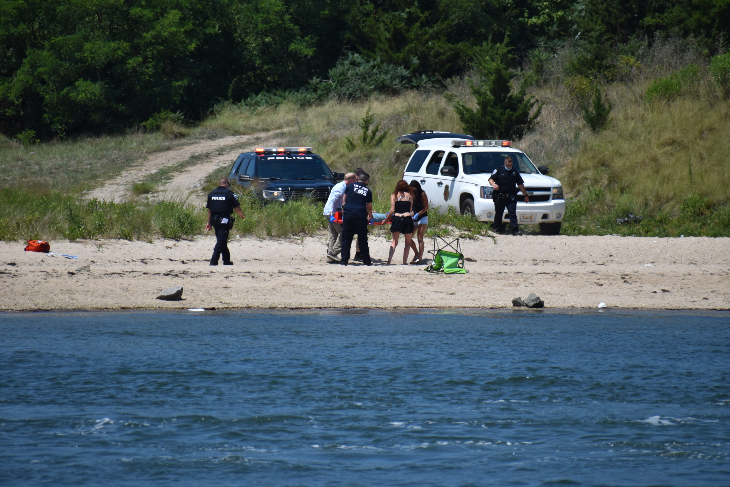 First responders pulled three swimmers from the water near North Haven Bridge Sunday. STEPHEN KOTZ