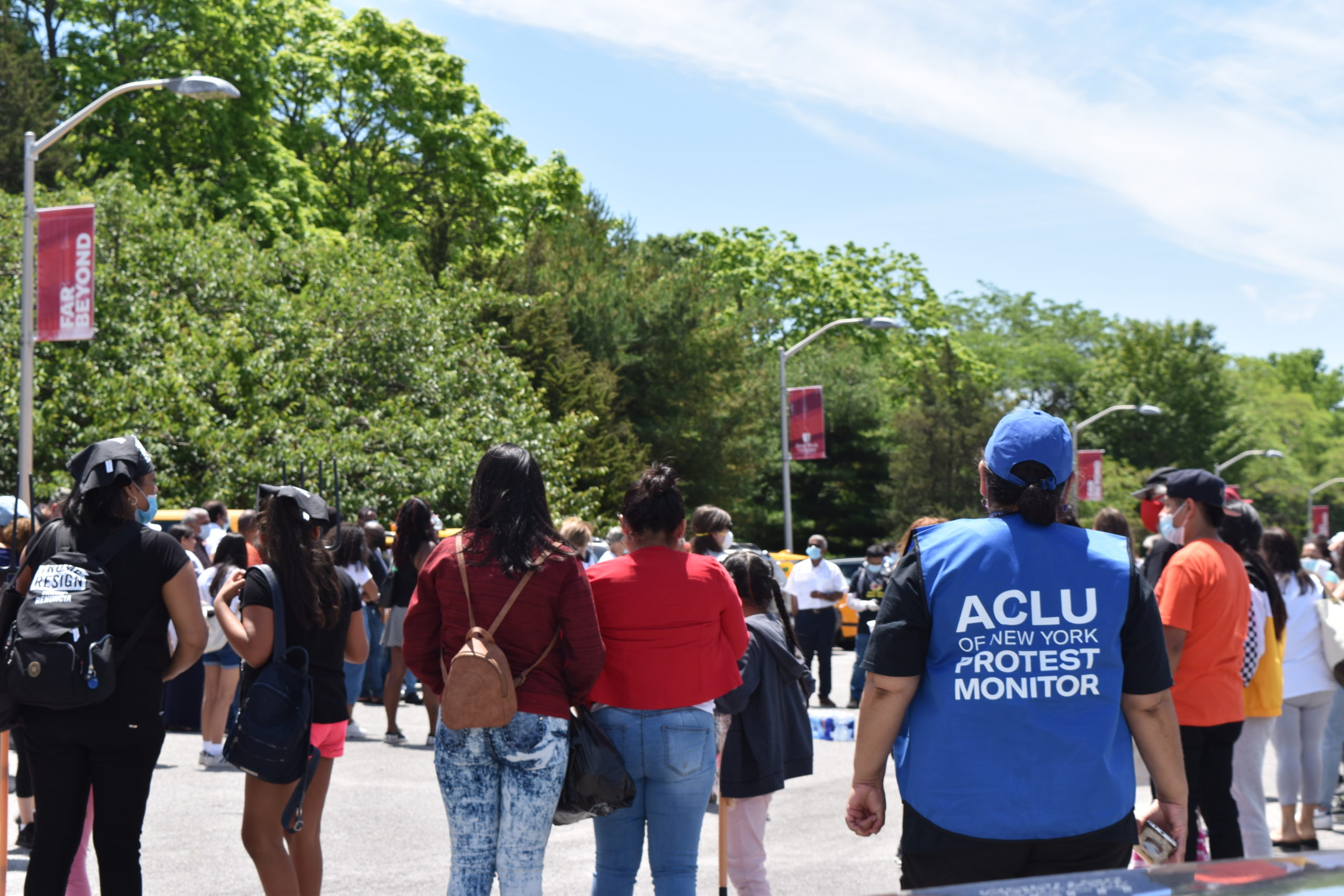 Before traveling to former New York City Mayor Michael Bloomberg's home, protesters in the caravan gathered in the parking lot of Stony Brook University's Southampton campus.