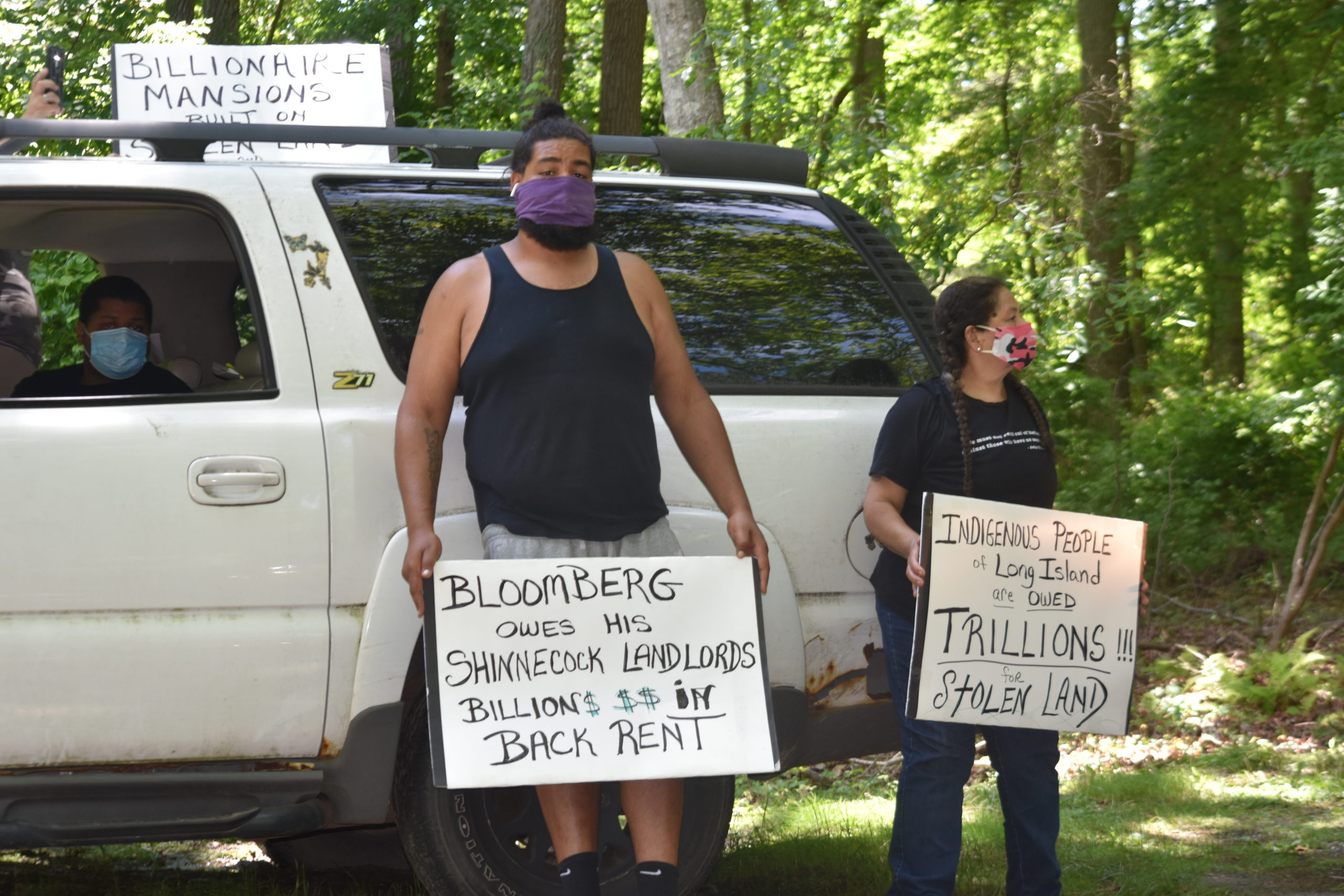 A protest caravan descened on the homes of East End billionaires, incluing the home of former New York City Mayor Michael Bloomberg, Wednesday with demonstrators demanding that Gov. Andrew Cuomo implement a wealth tax.