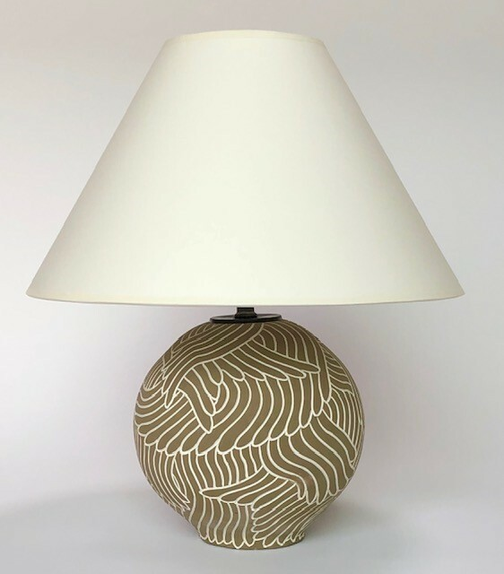 • Ceramic stoneware table lamp with spherical form on foot, white hand-carved feather drawing into a khaki background underglaze. Donated by David Netto.