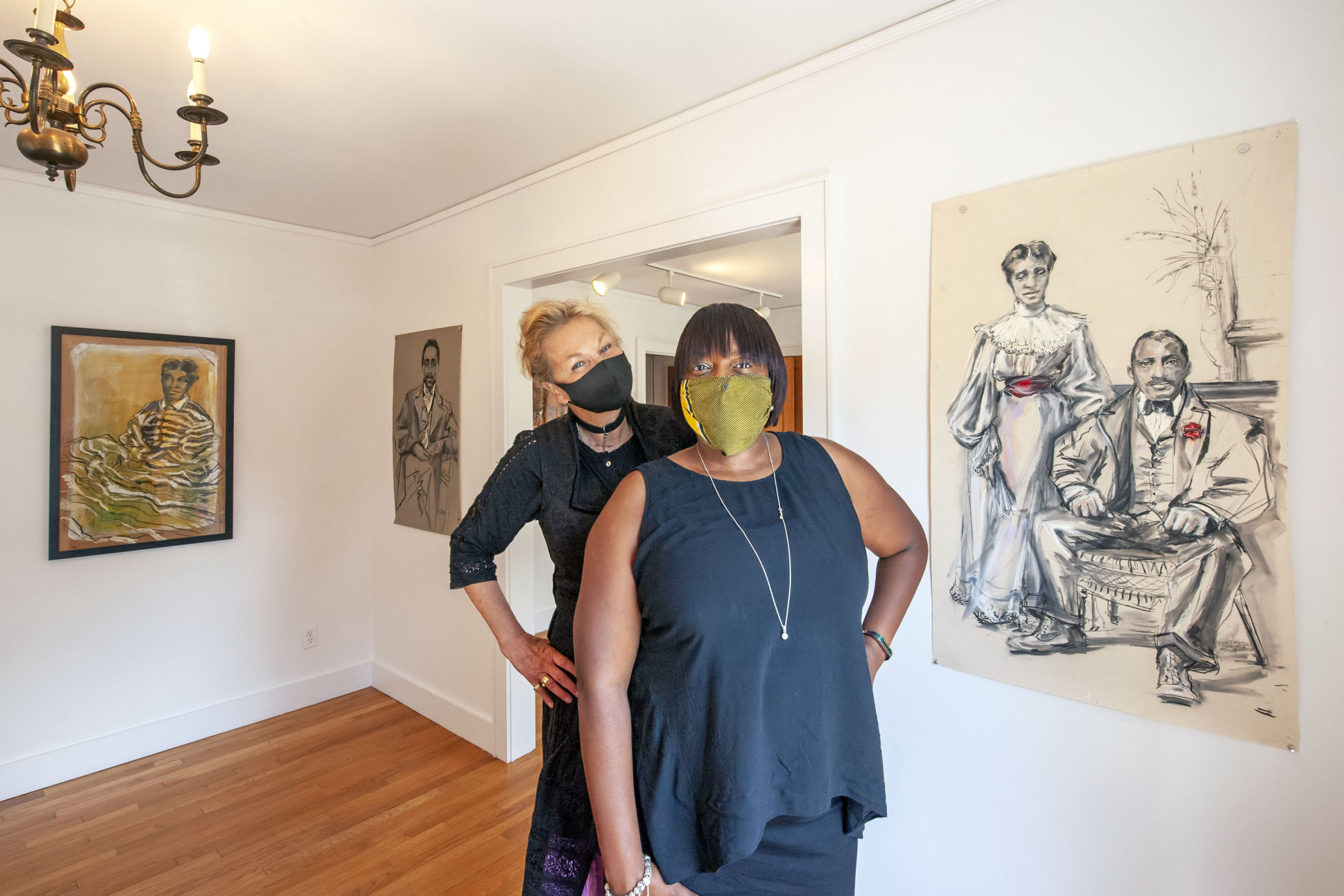 Artist Sabina Streeter with Eastville Historical Society's Dr. Georgette Grier just prior to the opening of Streeter's exhibition at the Society's Heritage House on Saturday. MICHAEL HELLER