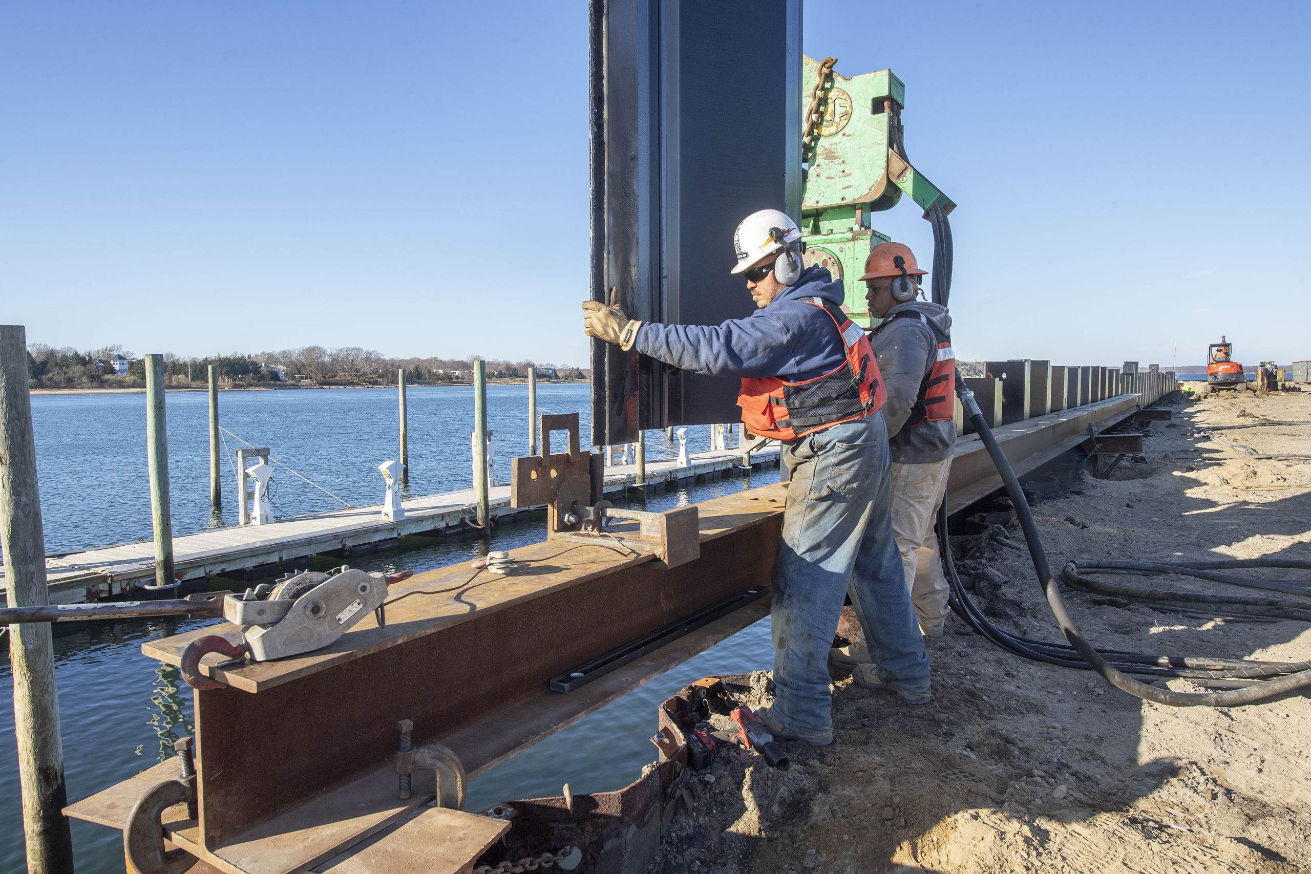 Workers installed new sheathing around Long Wharf in Sag Haror as part of a major restoration project that is almost complete. MICHAEL HELLER