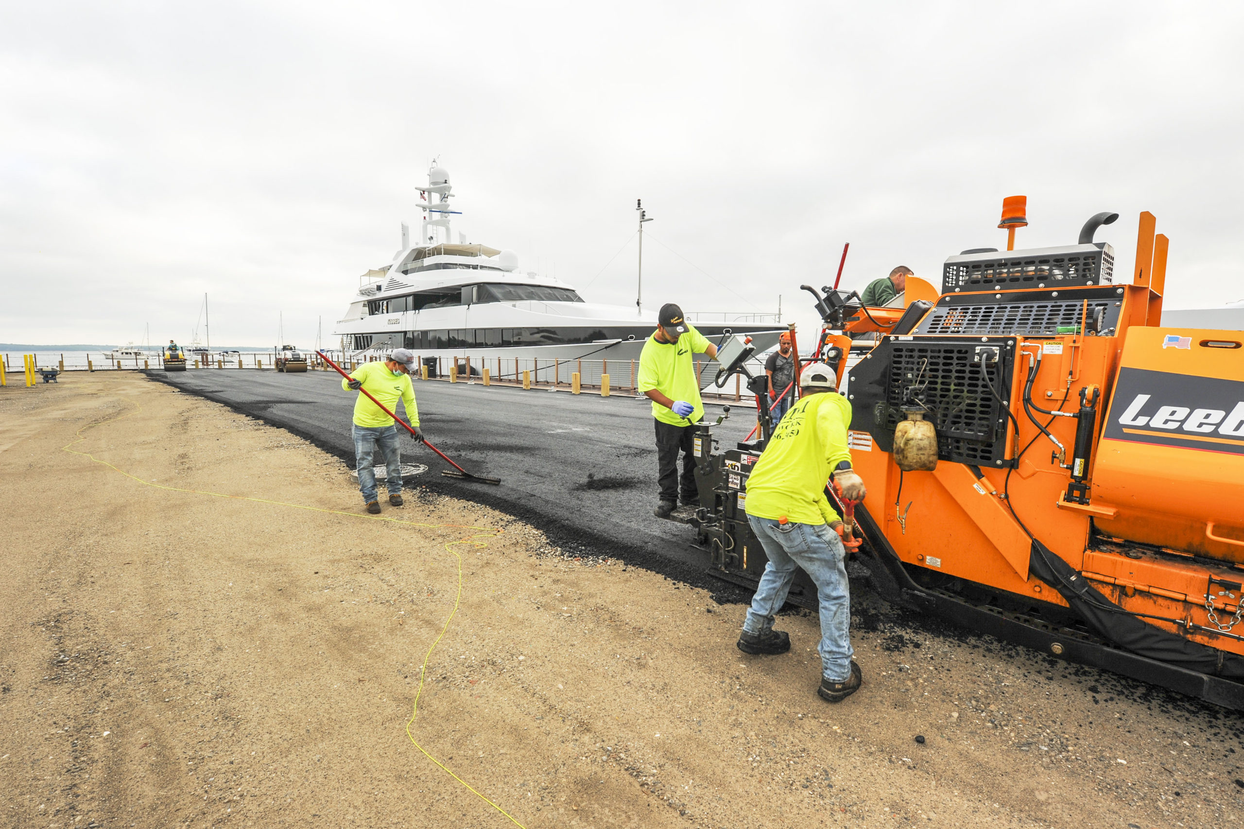 Workers were busy paving Long Wharf in Sag Harbor in anticipation of its reopening in time for the July 4 weekend. MICHAEL HELLER