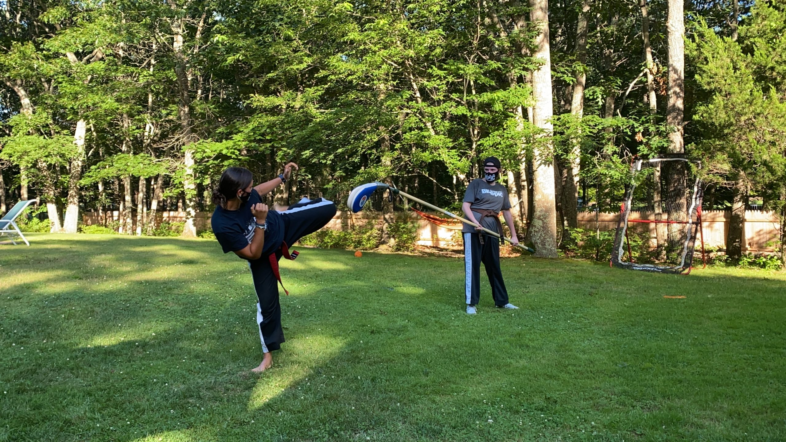 Emiley Nill, black belt at Epic Martial Arts, teaches an outdoor Martial Arts Class