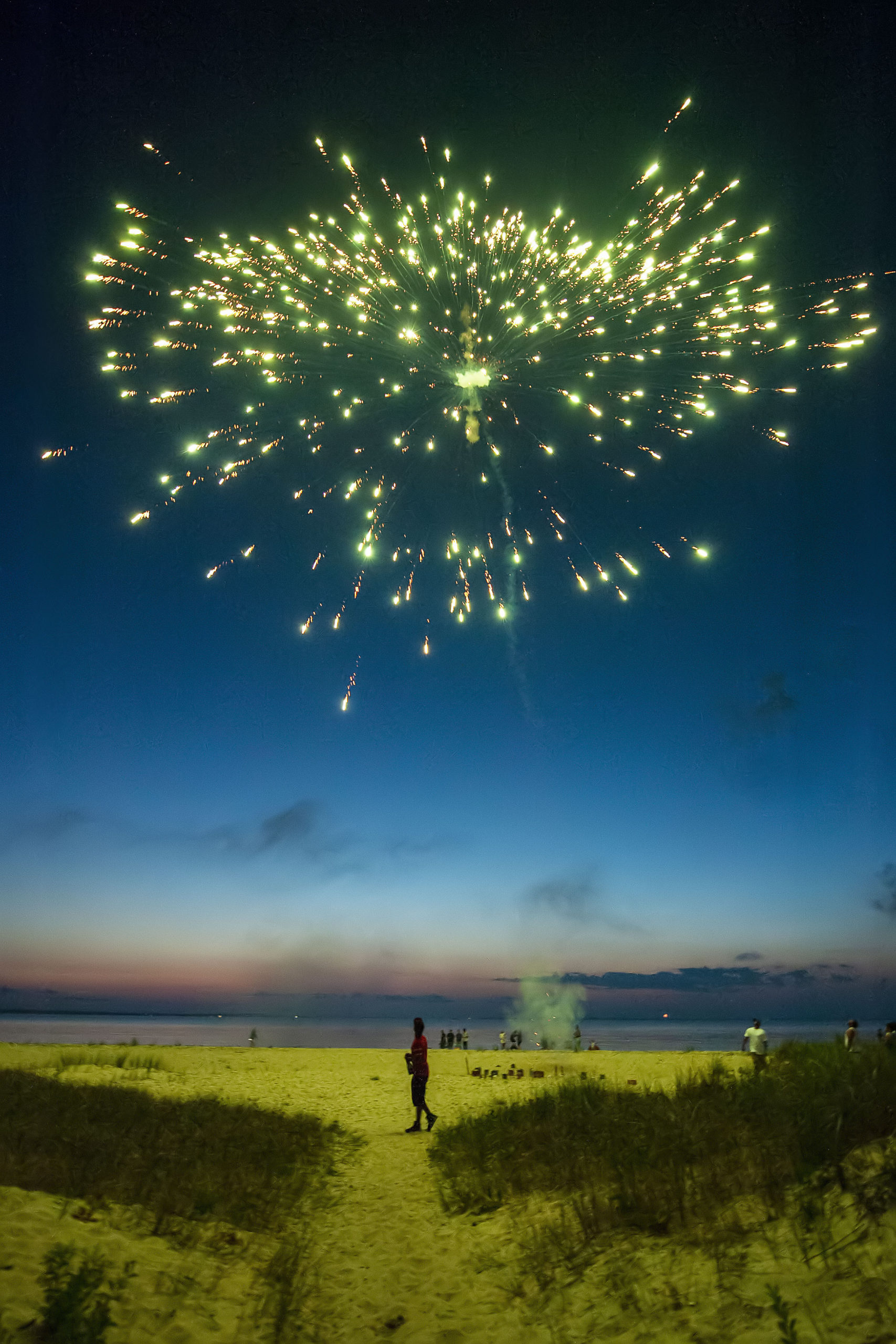 A group of friends sets off their own fireworks on the beach as part of a July 4th celebration as the sun goes down at Maidstone Park Beach on Saturday evening. MICHAEL HELLER