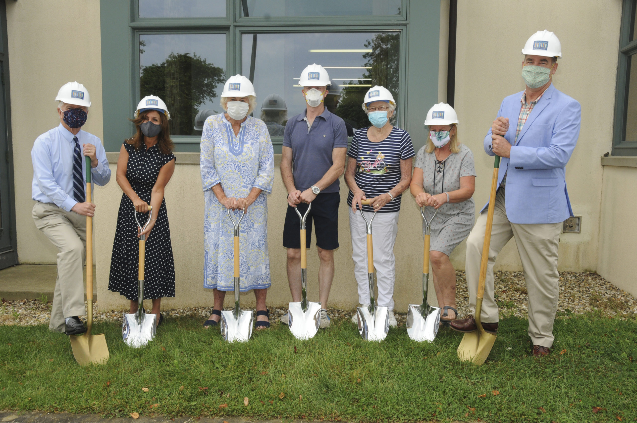 State Assemblyman Fred W. Thiele Jr., Montauk Library Director Denise DiPaolo, Library Board President Joan Lycke, Library Trustee Carter Tyler, Trustee Lynda Bostrom, Trustee Marilyn Levine and East Hampton Town Supervisor Peter Van Scoyoc at the Montauk Library expansion and renovation building project groundbreaking ceremony on Friday, July 24. RICHARD LEWIN
