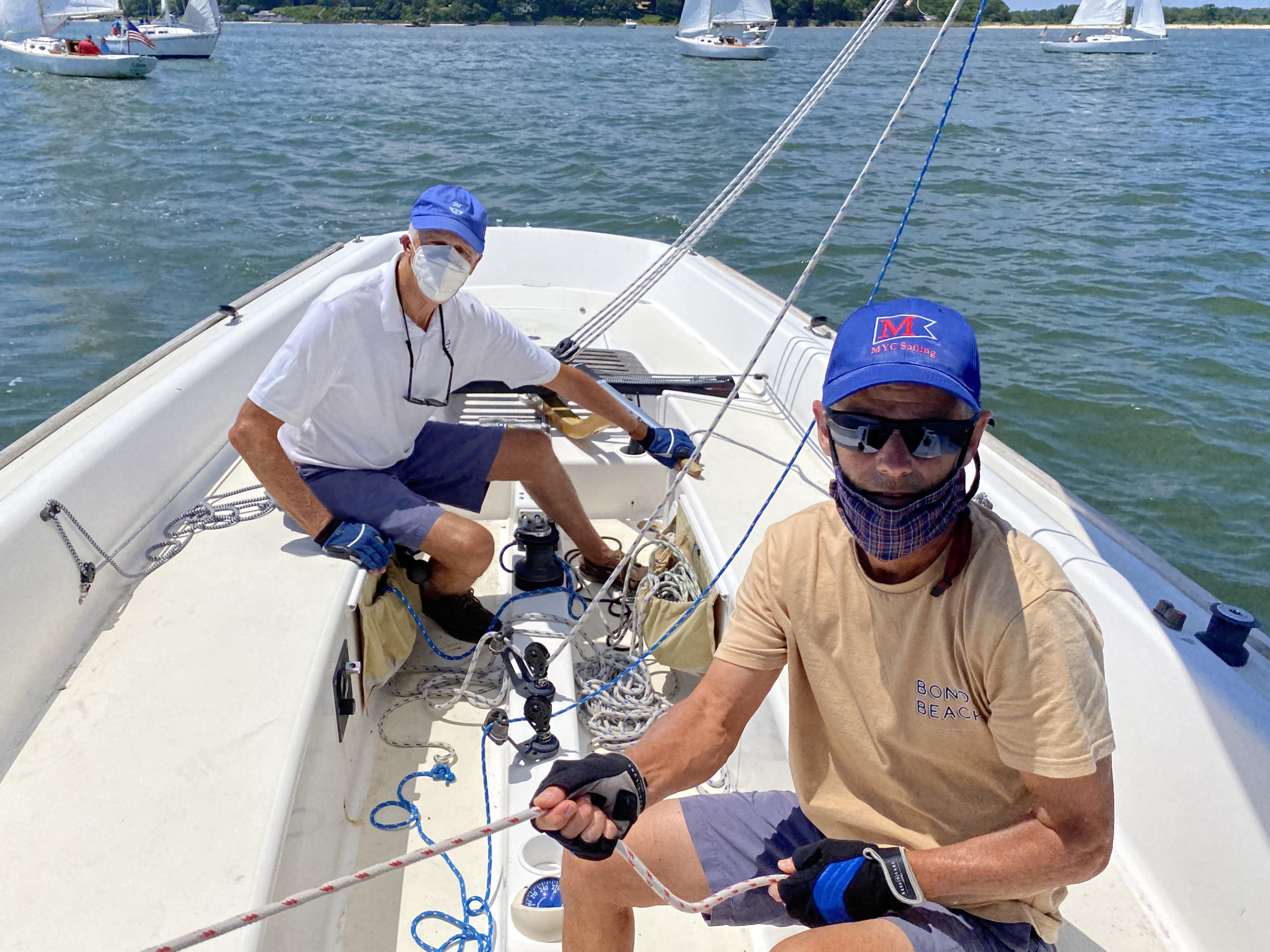 Captain Mark Rickabaugh and jib sheet trimmer Bill Edwards aboard the e-33 yacht, Entropy during the Peconic Bay Sailing Association race on Saturday hosted by the New Suffolk Old Cove Yacht Club.     MICHAEL MELLA