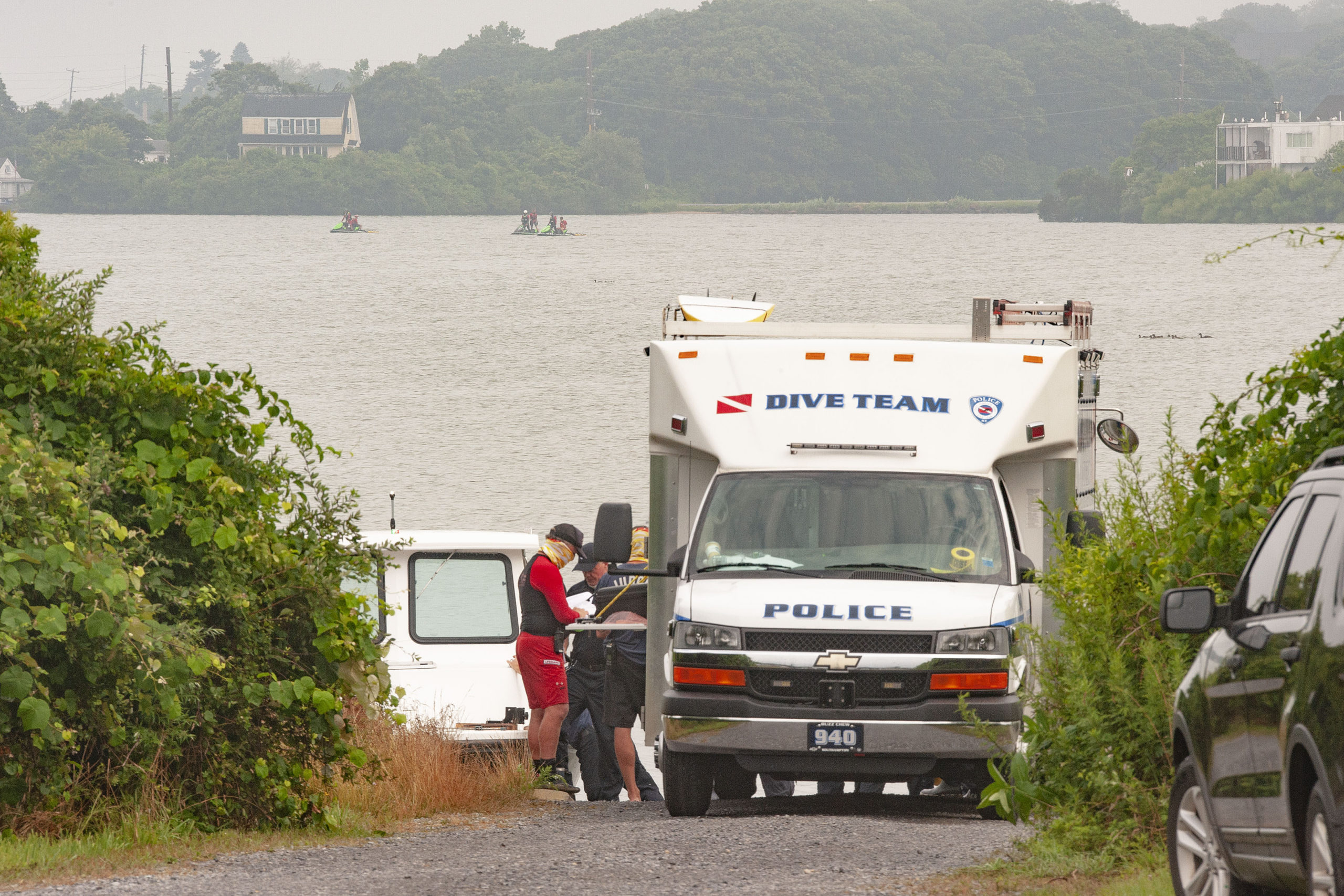 Dive teams and lifeguards resumed searching for the missing swimmer on Monday morning.