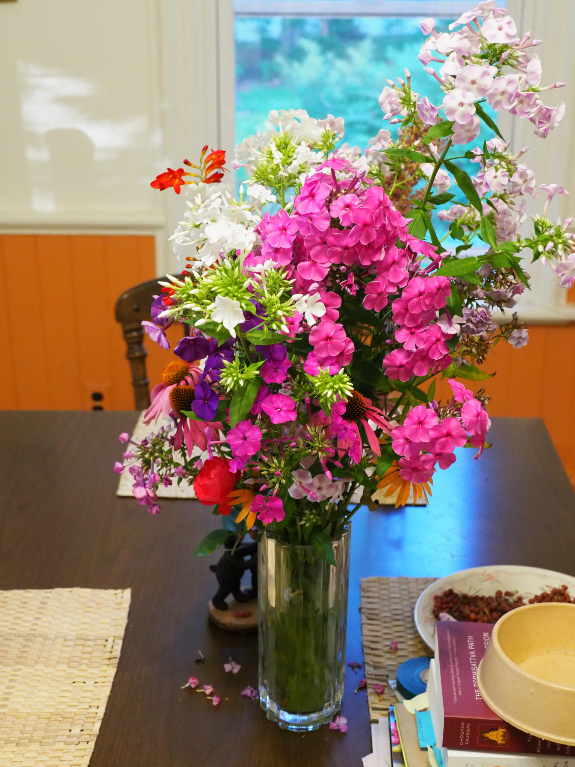 Cut flowers are always on the Hampton Gardener's kitchen table from April through November. This August vase contains six varieties of tall garden Phlox (Phlox paniculate) with a stem of Crocosmia and a few brown-eyed daisies.
