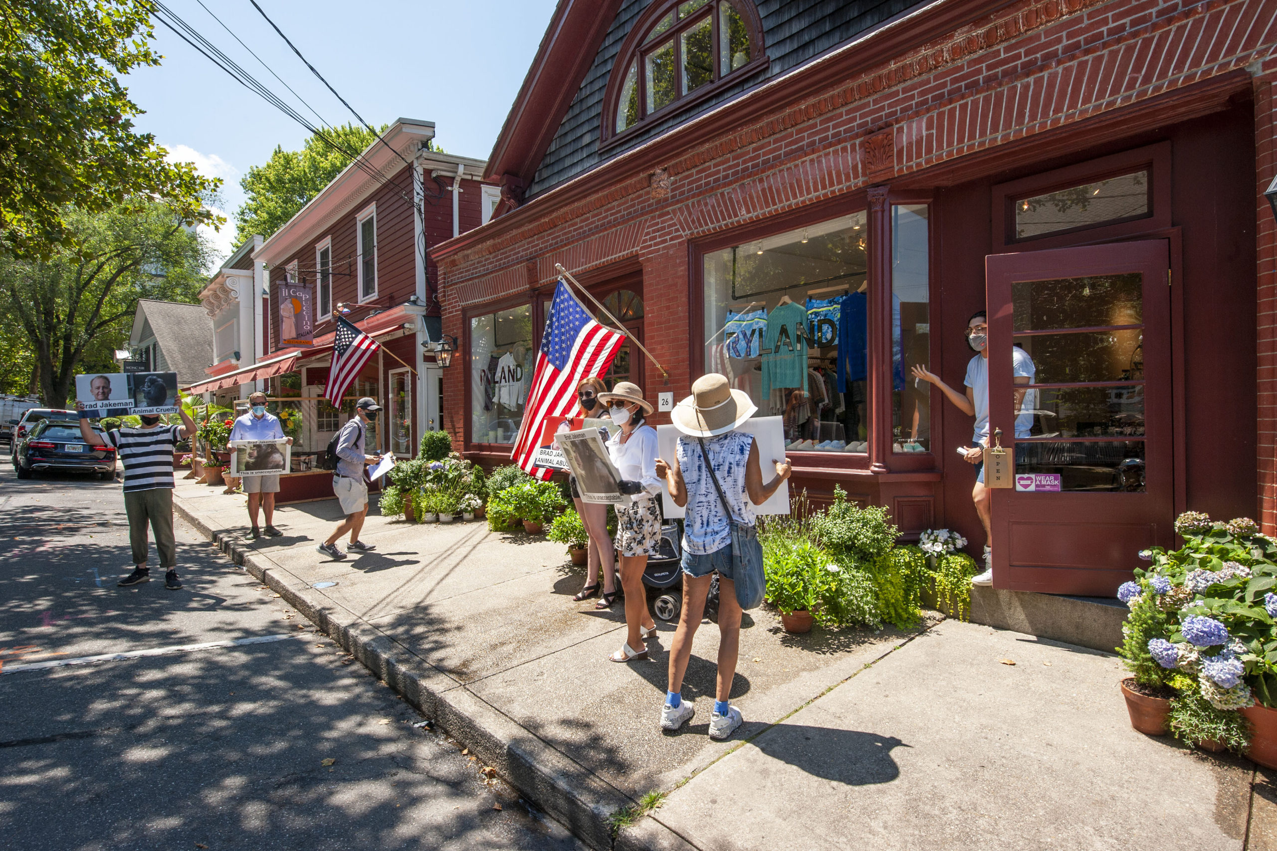 Protesters gathered on Madison Street in Sag Harbor on Saturday. MICHAEL HELLER