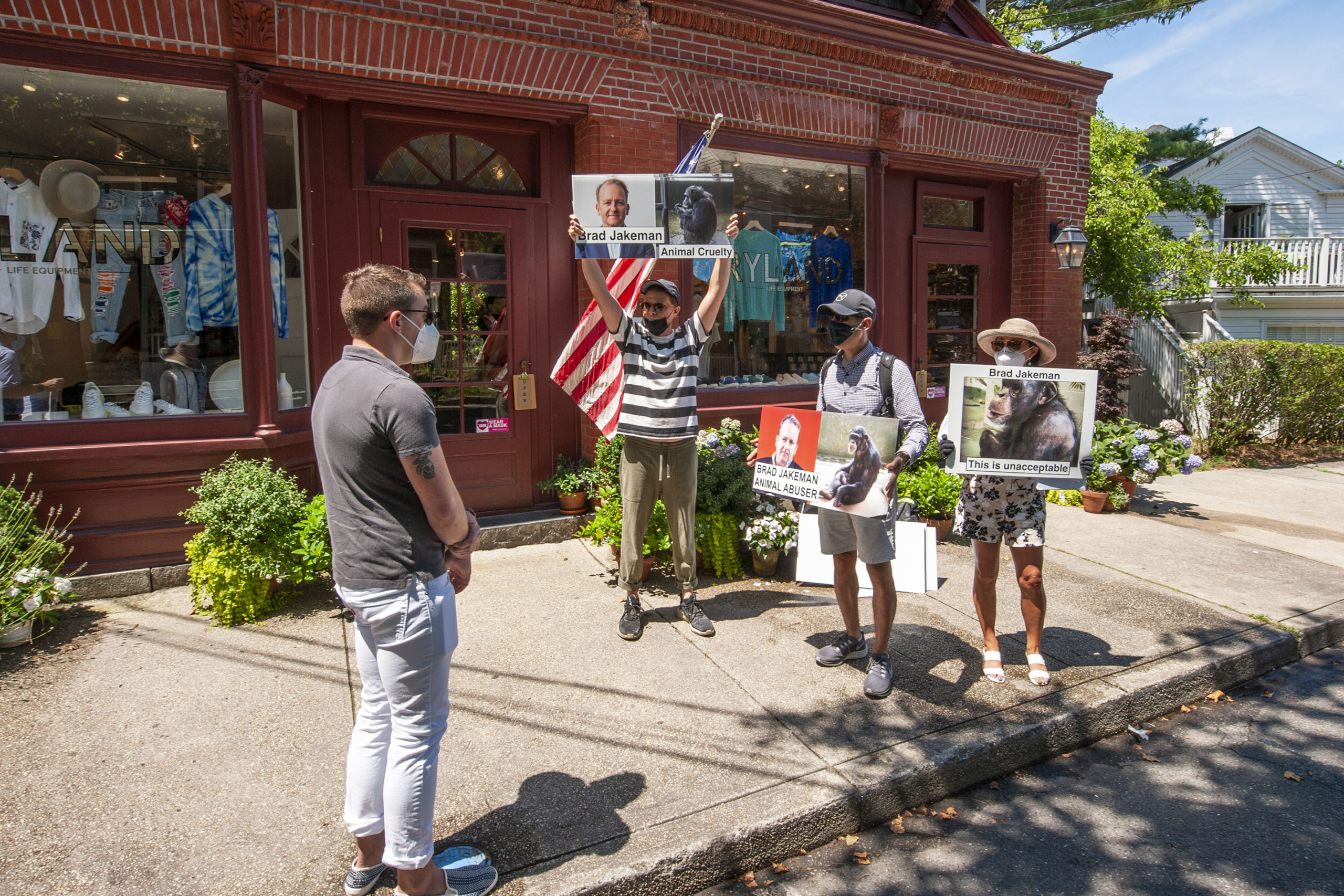 Protesters gathered on Madison Street in Sag Harbor on Saturday, July 25, demonstrating against mistreatment of chimpanzees at a Georgia sancturary. MICHAEL HELLER