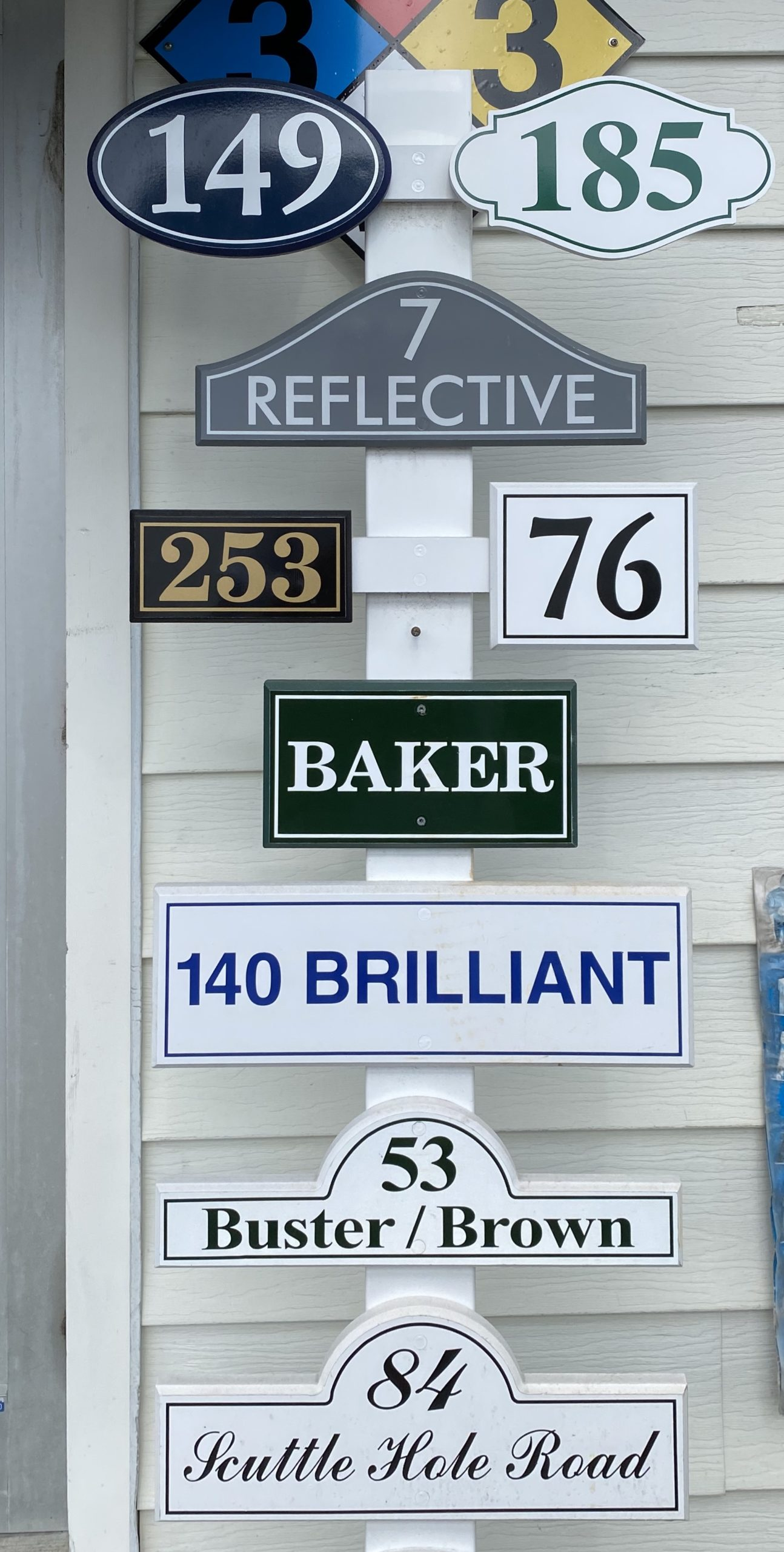 Display of sign styles available at Herrick Hardware on Main Street in Southampton Village.