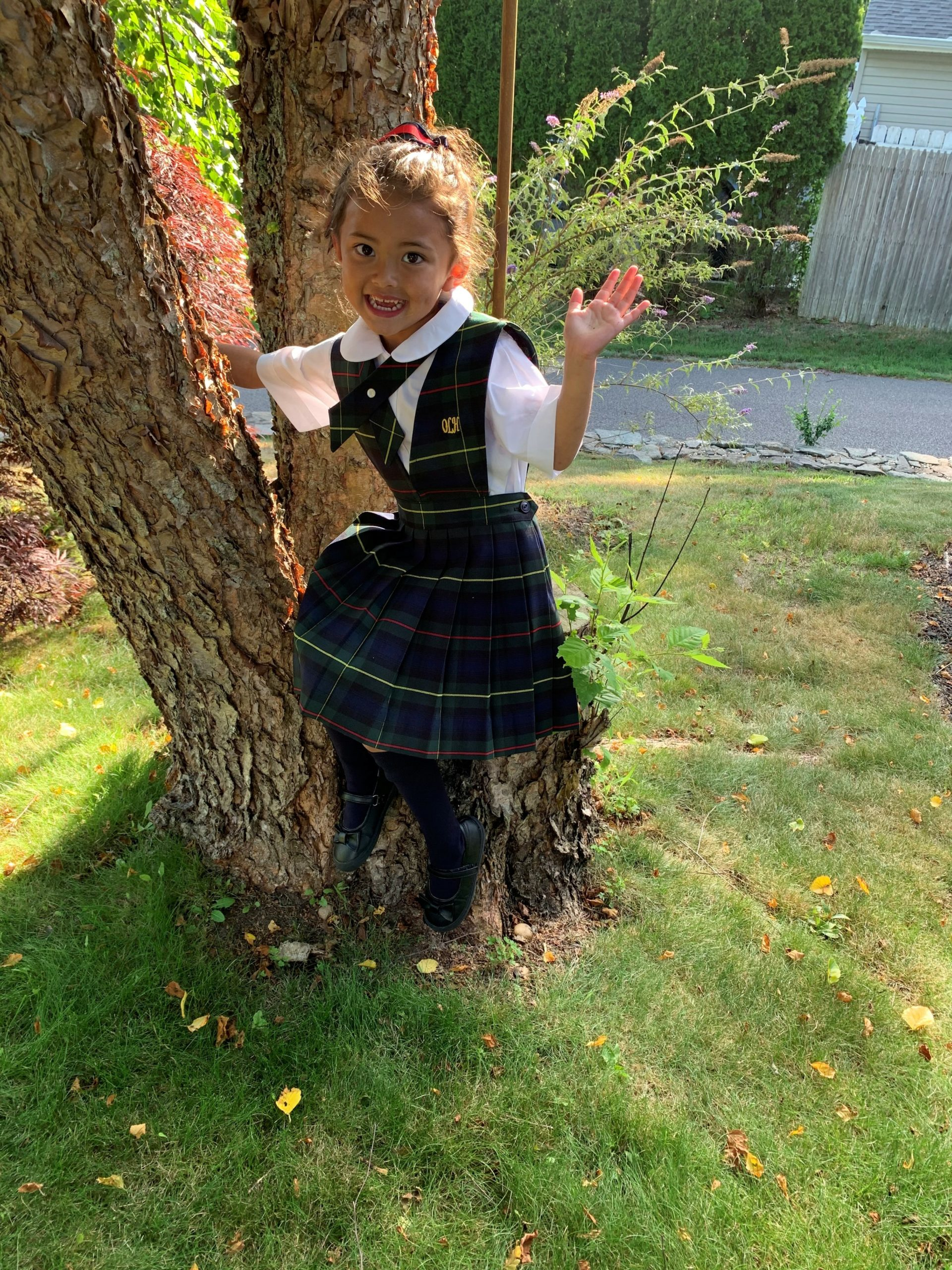 New kindergartner Myla Turnbull tried on her new OLH uniform for the first time.