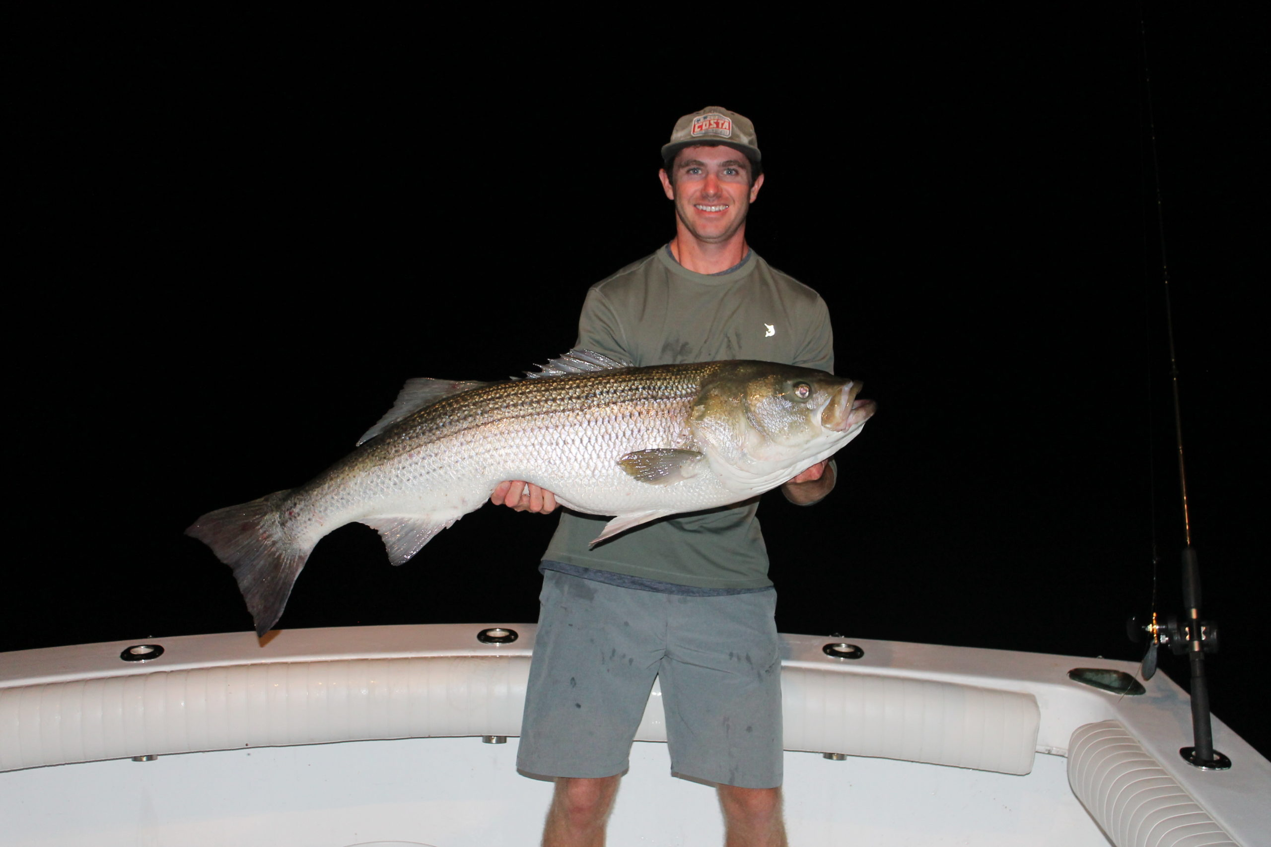 Hunter Wilcox with a big striped bass caught while fishing at night off Montauk Point with Capt. Ben McCarron of Push The Limit Sportfishing.