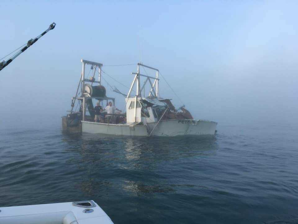 A photo of the Petrel immediately after it was struck on Saturday morning by another boat in heavy fog. The Petrel sunk less than three minutes later. Both the crewmen were rescued by the other boat.