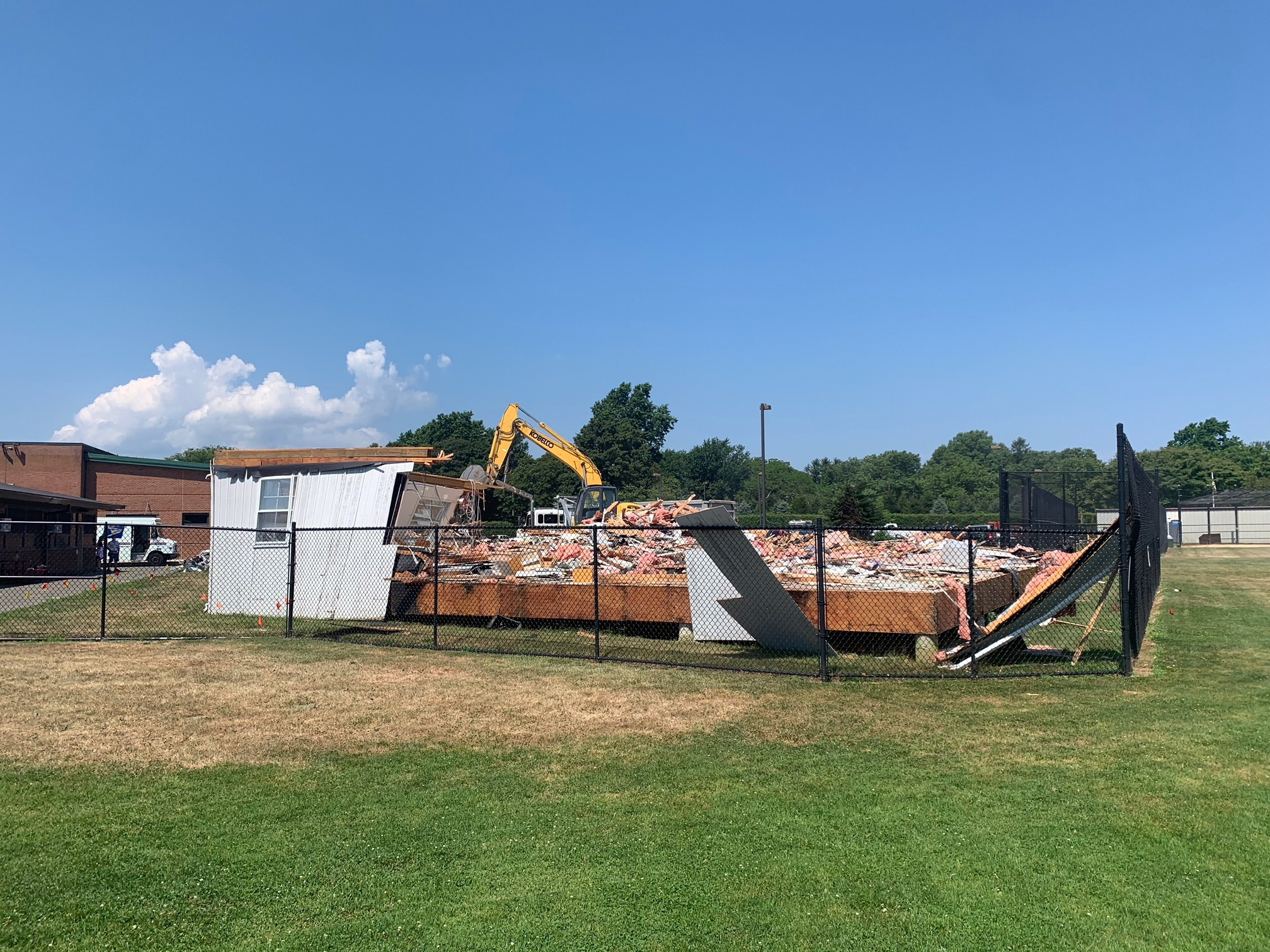 Demolition on the Southampton Schools campus took down the old administrative offices Tuesday. MARCUS DASILVA