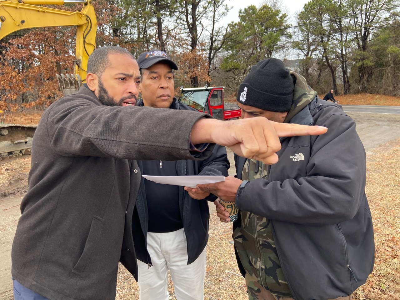 Tribal Trustees Bryan Polite and Lance Gumbs with tribe member Barre Hamp at the work site recently. COURTESY SHINNECOCK NATION